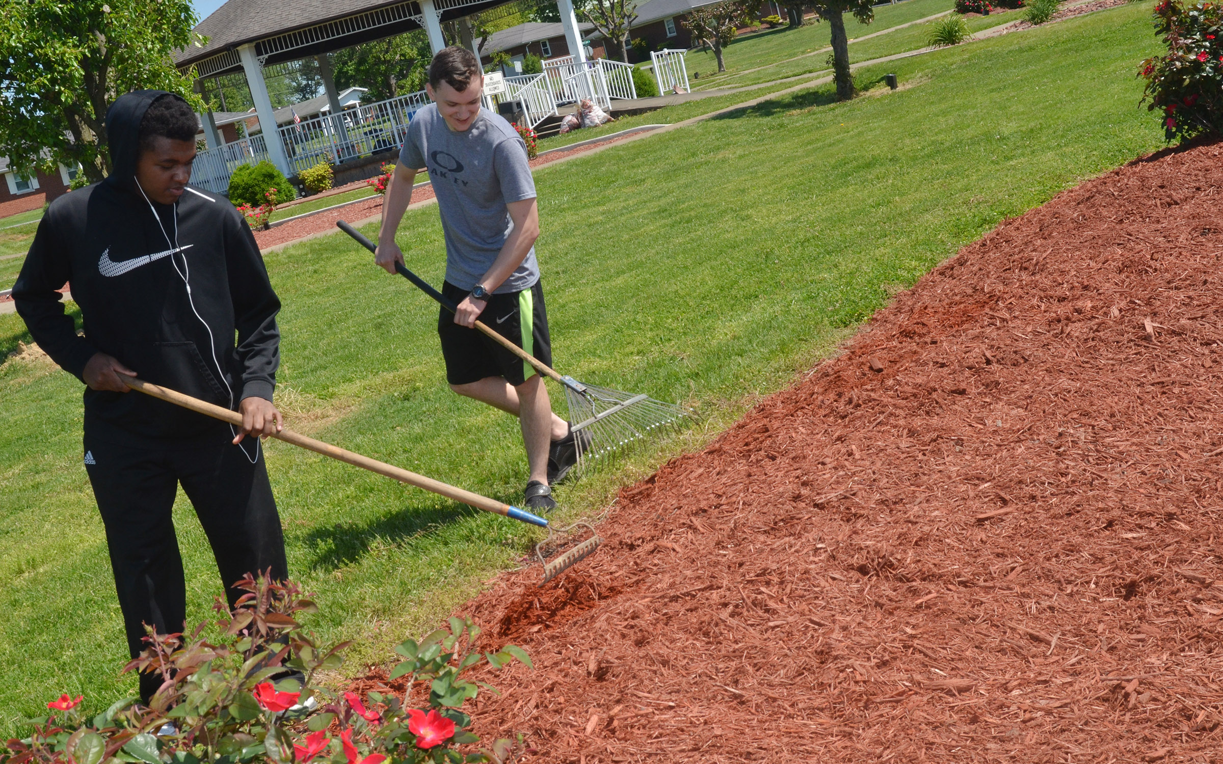 CHS seniors Darius Bell, at left, and Jonathan Rakes spread mulch at Miller Park.