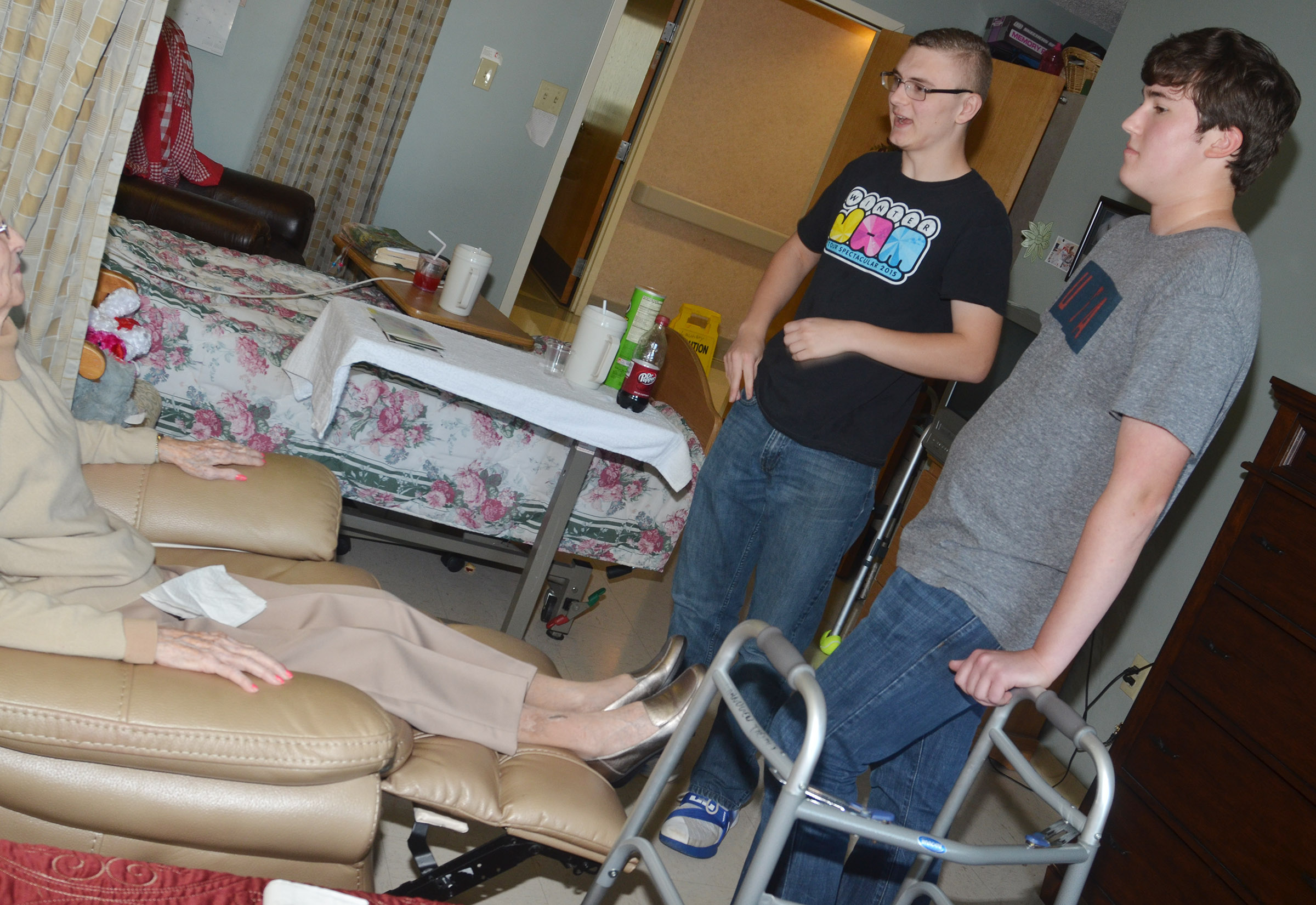 CHS seniors Ben Rafferty, at left, and Zack Settle visit with Grandview residents.