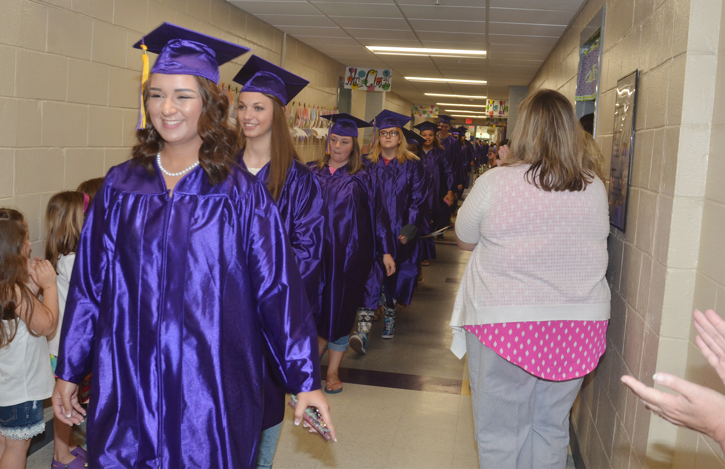 CHS senior Kailey Morris and her classmates walk down the hallways at CES.