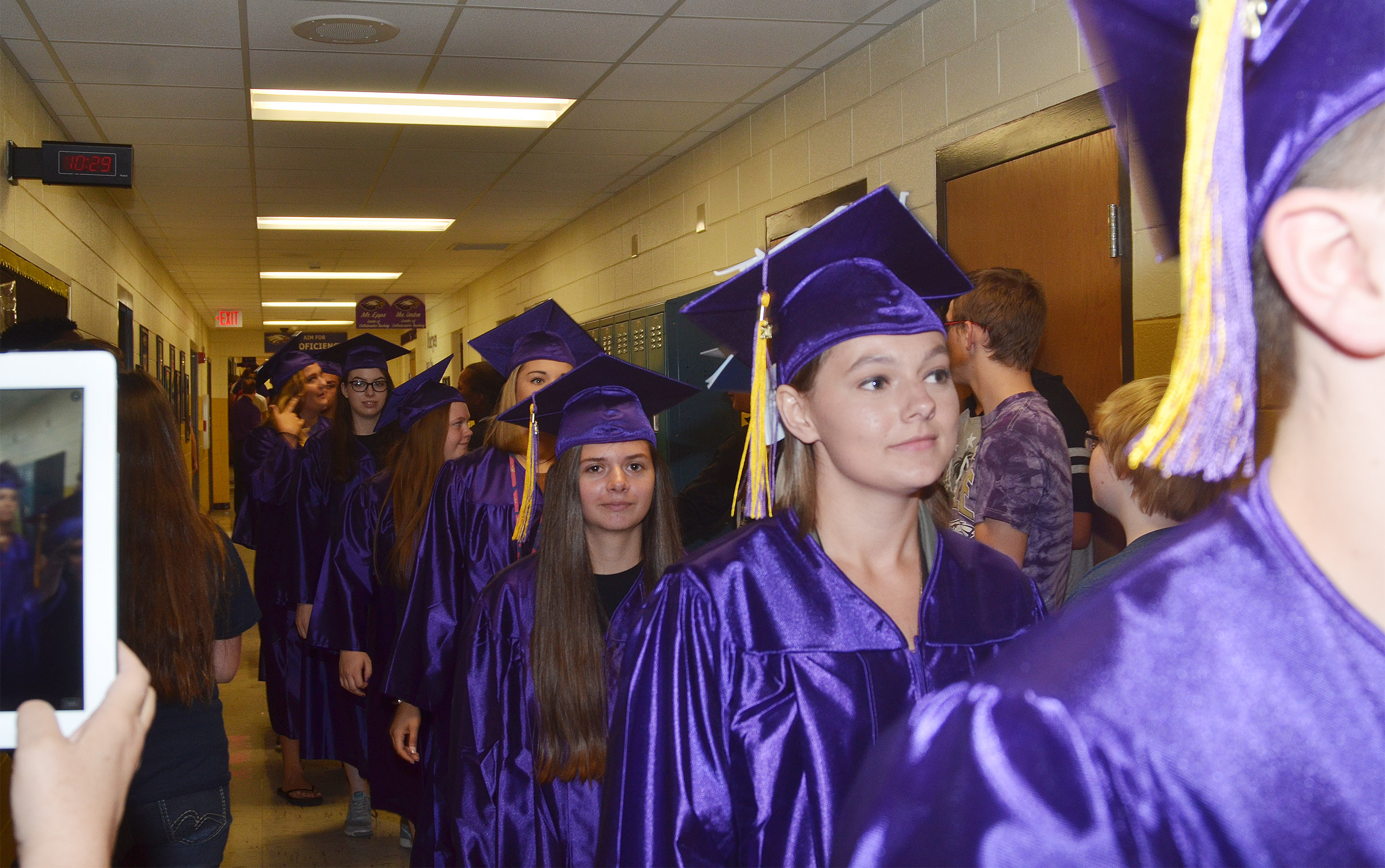 CHS senior Shauna Jones, at left, and Kyrsten Hill walk down the CHS hallways with their classmates.