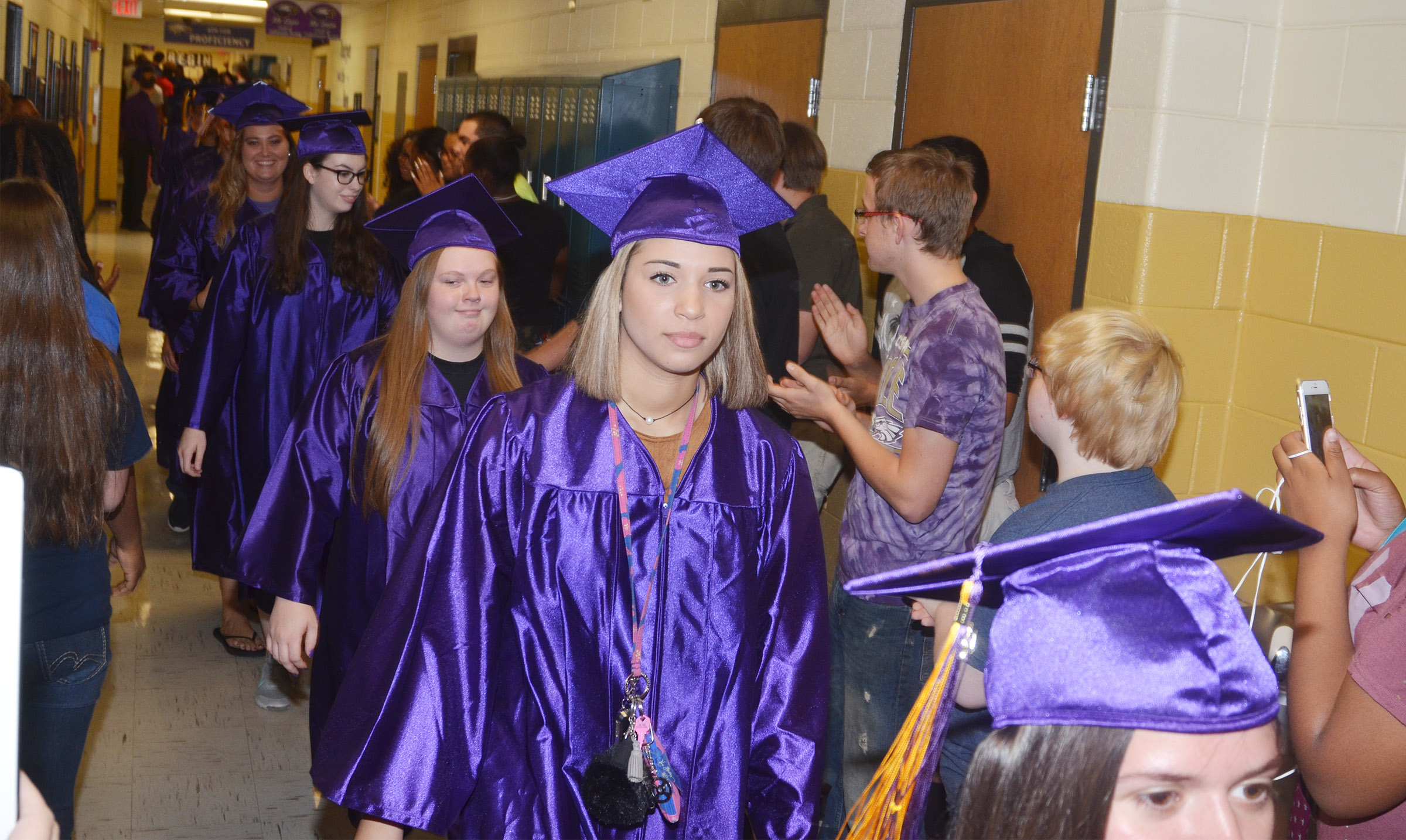 CHS senior Sidney Grady walks down the CHS hallways with her classmates.