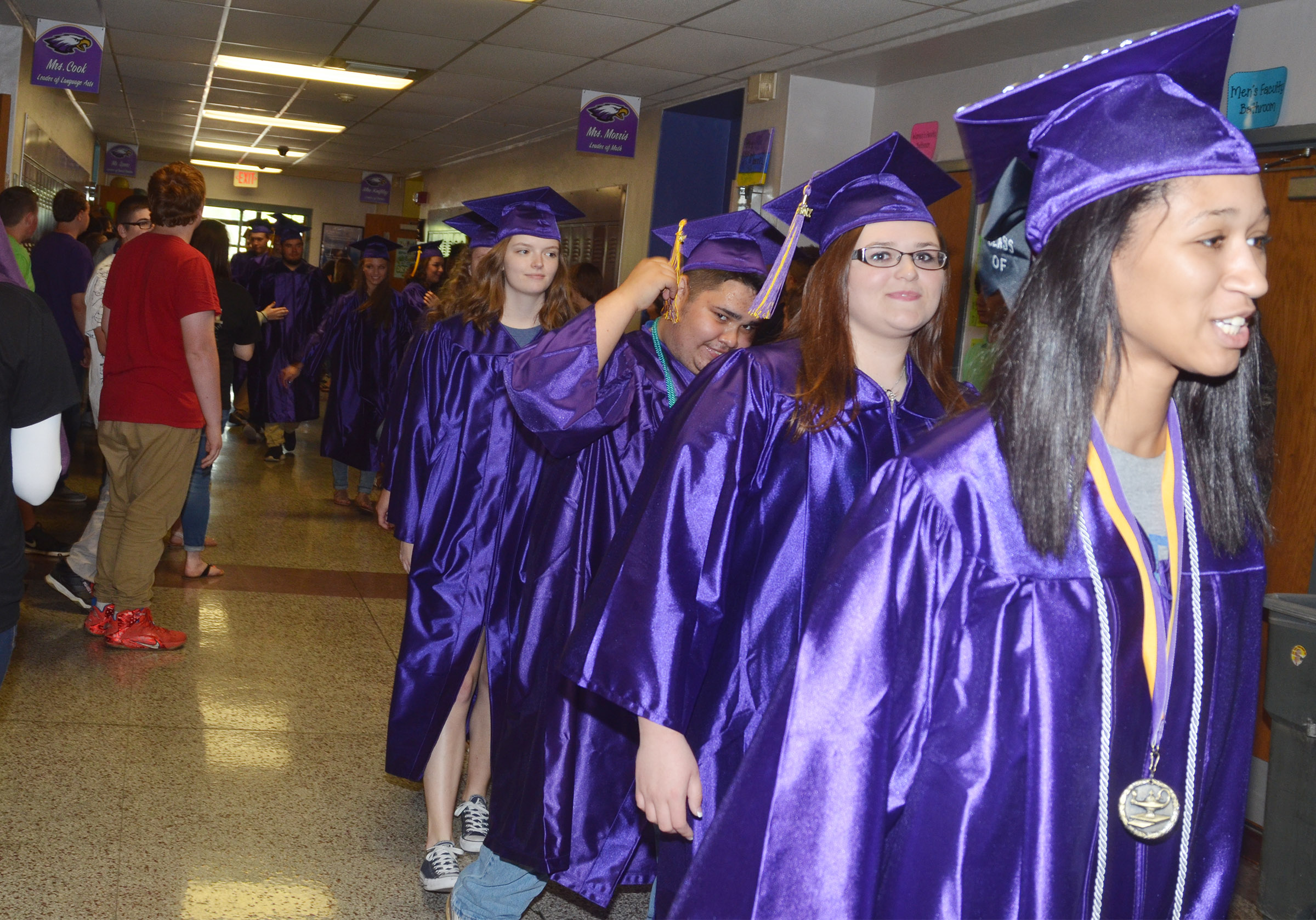 CHS seniors, from left, Blair Lamb, Robert Tungate, Vera Brown and Alexis Shears walk down the hallways at CMS.