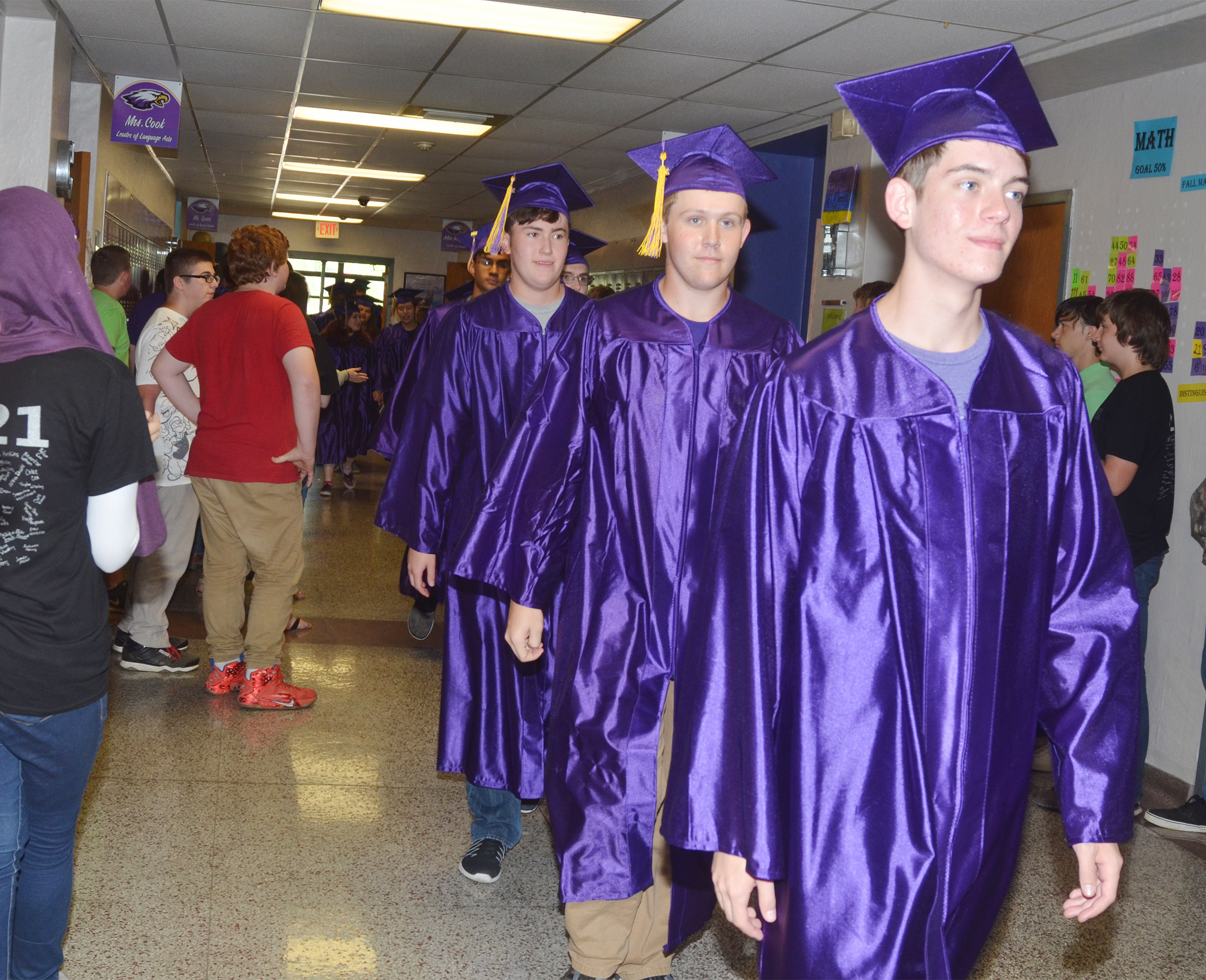 From left, CHS seniors Zack Settle, Jared Brewster and Murphy Lamb walk down the CMS hallways.