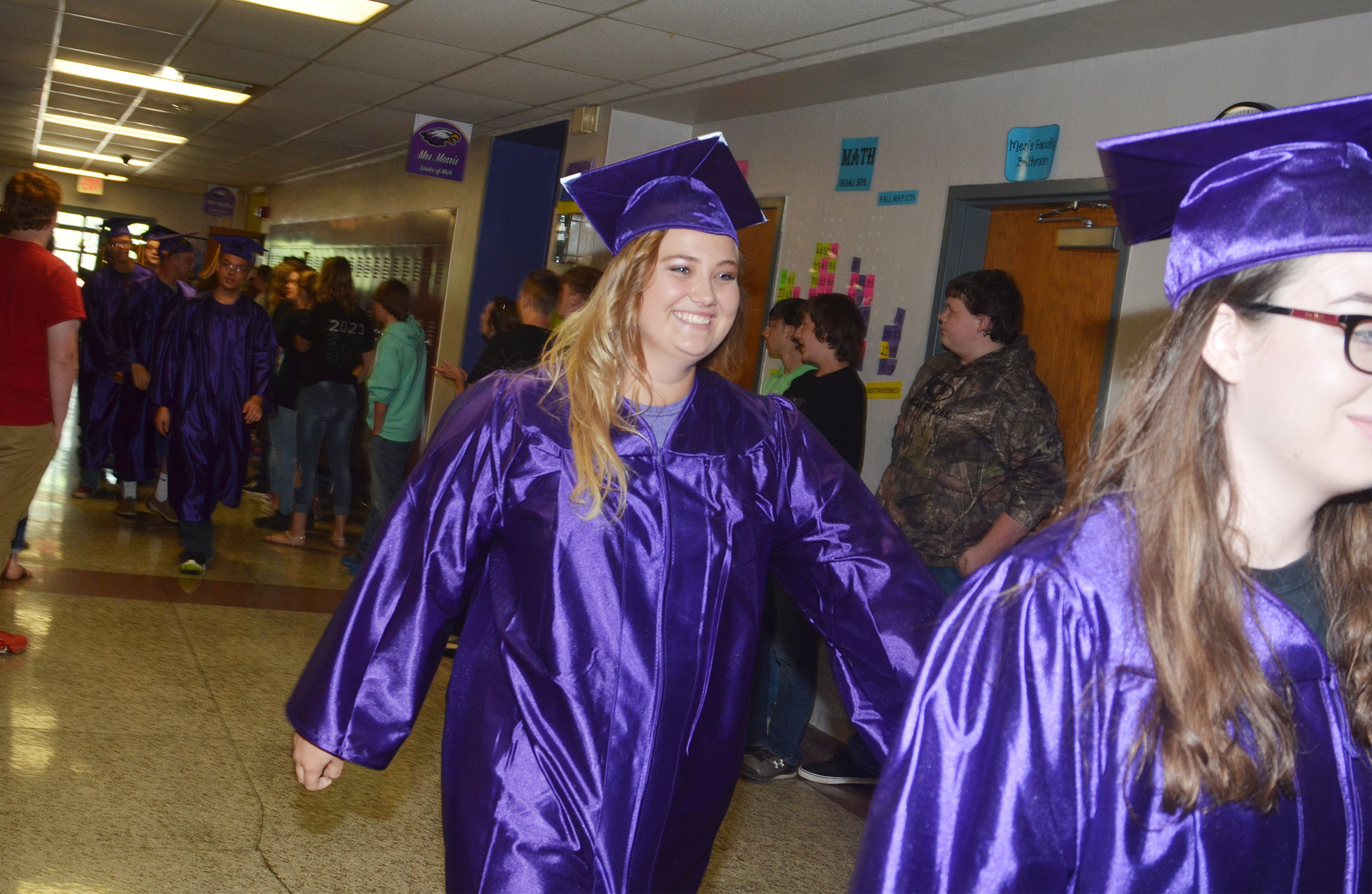 CHS senior Brenna Wethington smiles as she walks down the CMS hallways with her classmates.