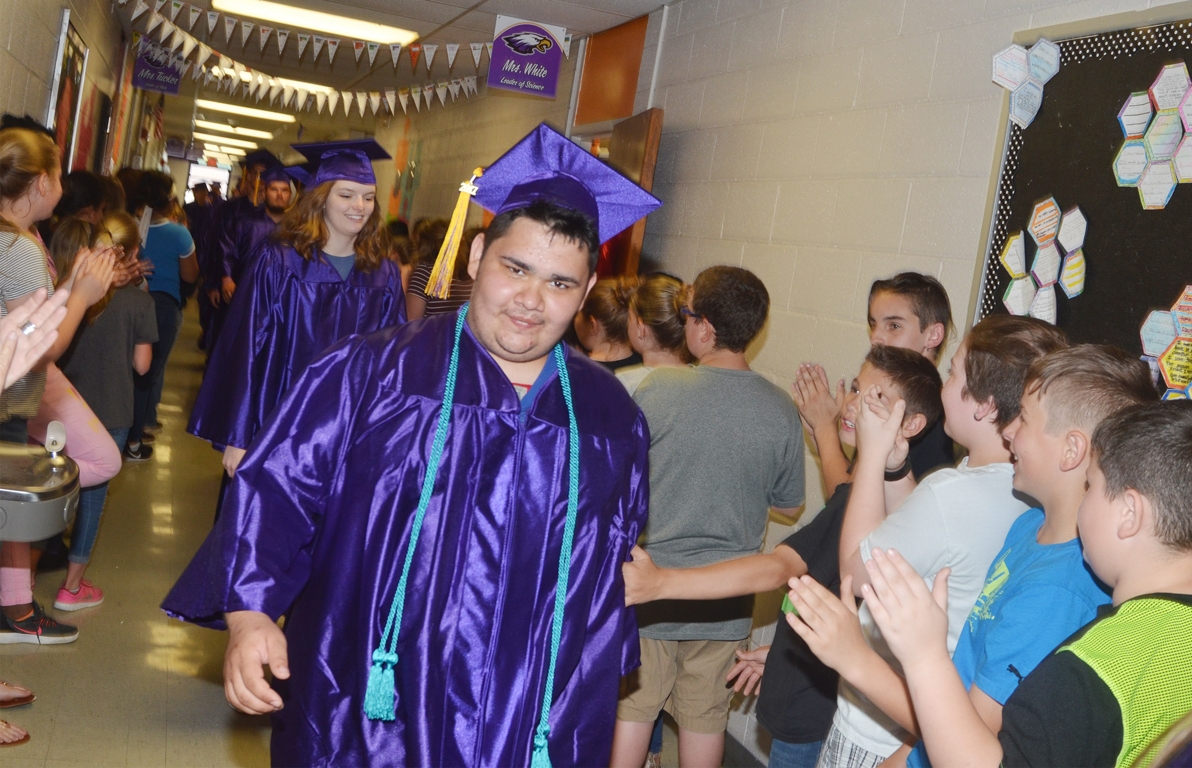 CHS senior Robert Tungate walks down the CMS hallways.