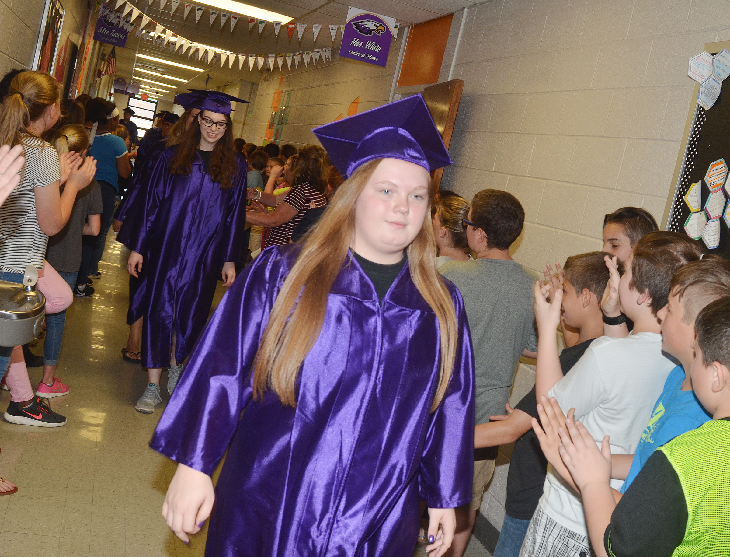 CHS senior Madison Lewis walks down the CMS hallways with her classmates.