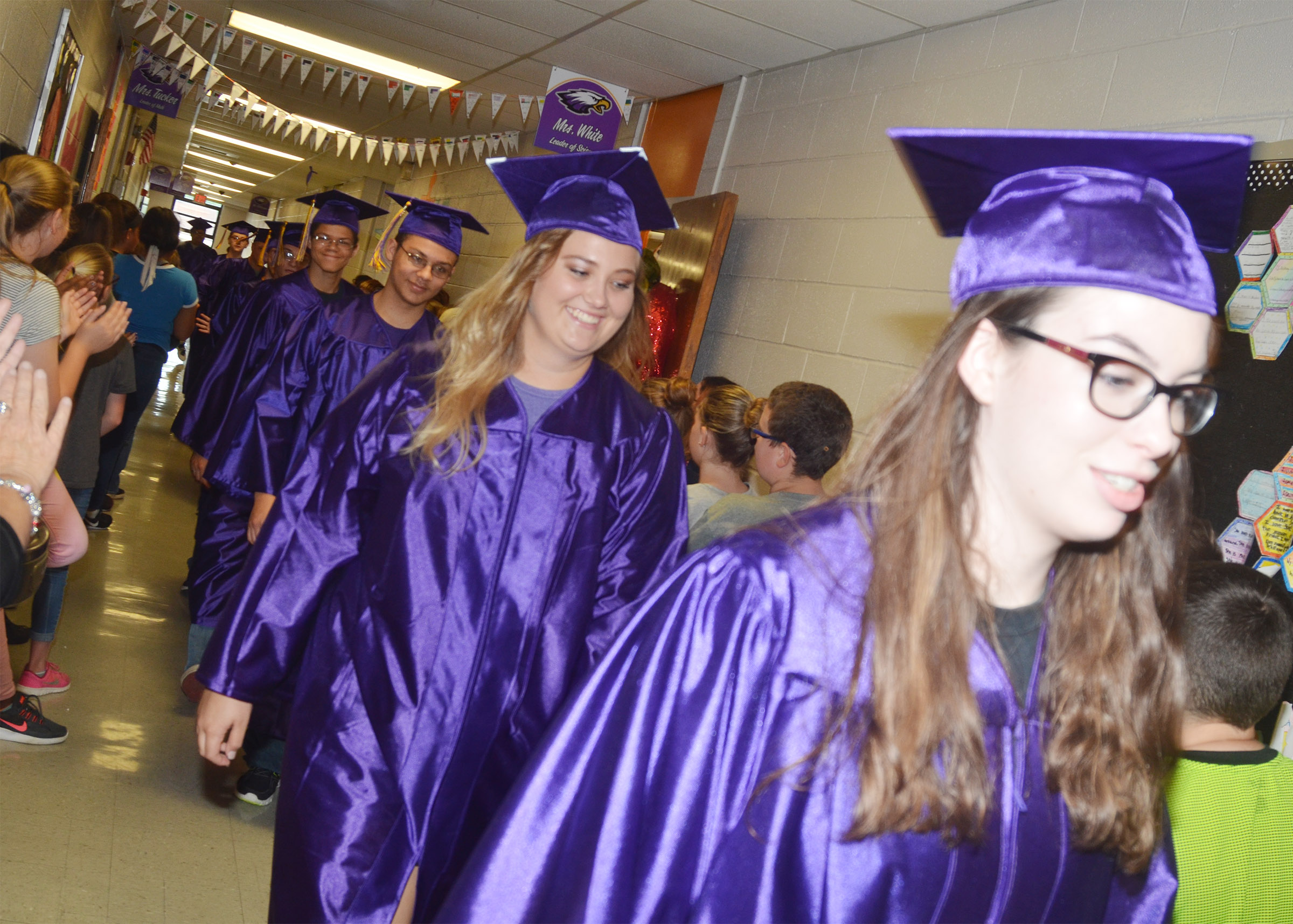 CHS seniors Brenna Wethington, at left, and Laura Lamb walk down the hallways at CMS.