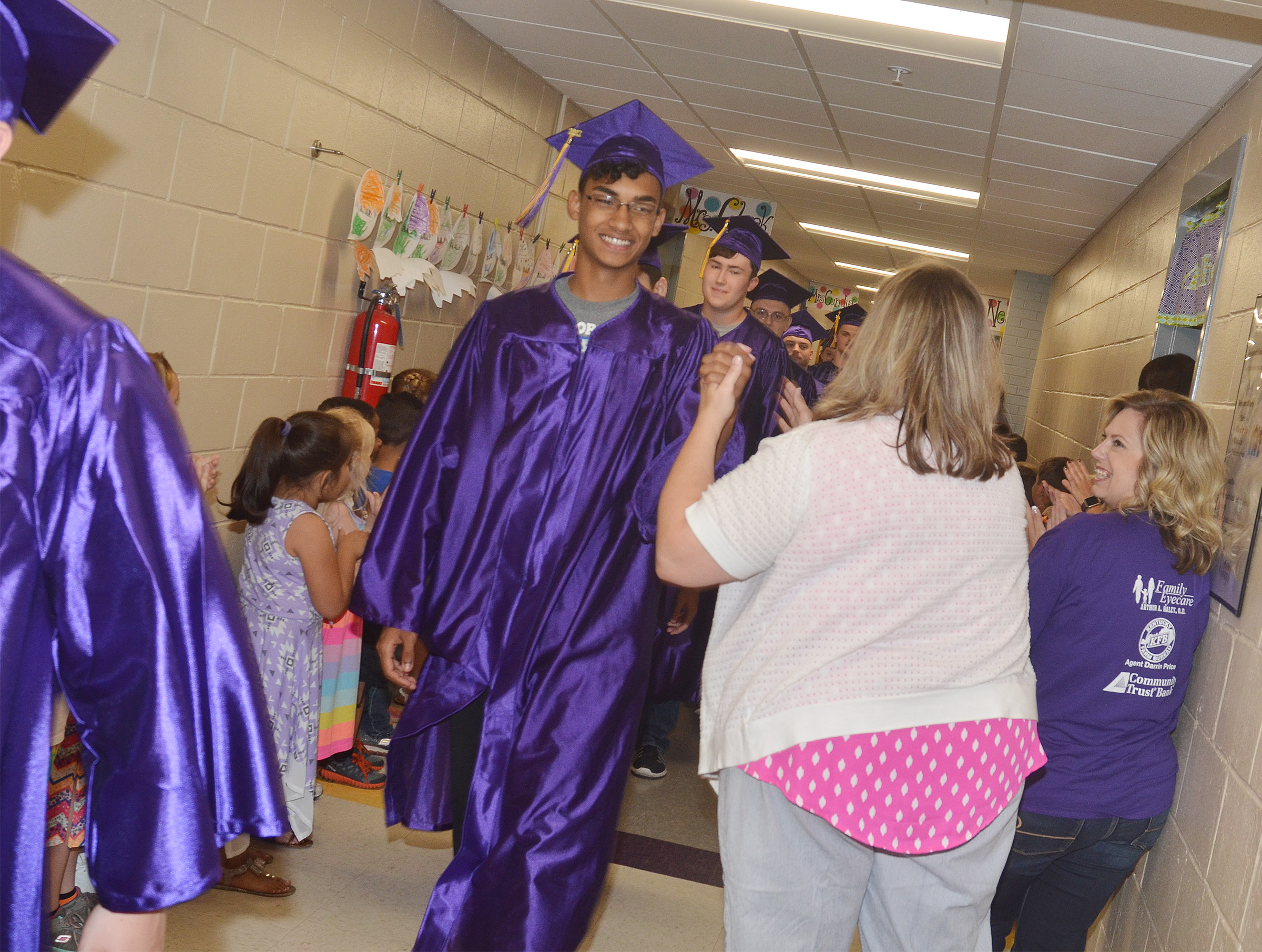 CHS senior Daniel Silva greets show choir director Cyndi Chadwick as he and his classmates walk down the hallways at CES.