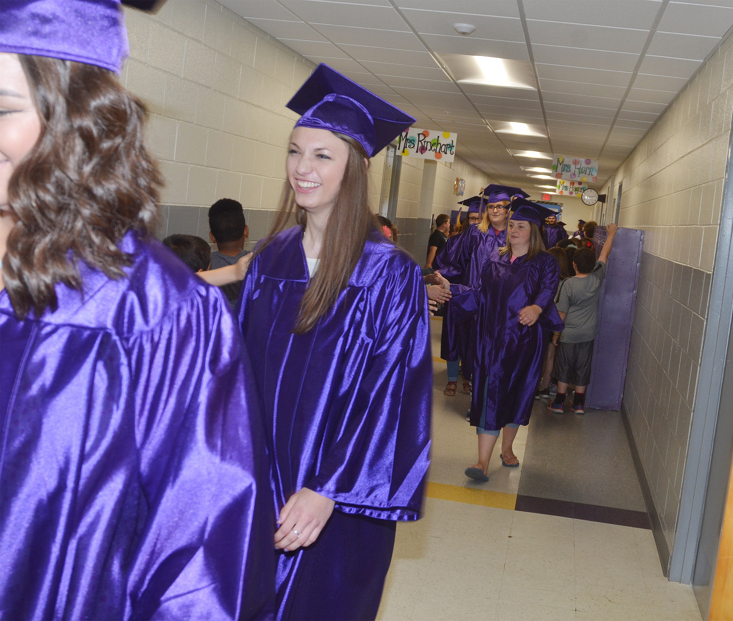 CHS senior Caylie Blair and her classmates walk down the hallways at CES.