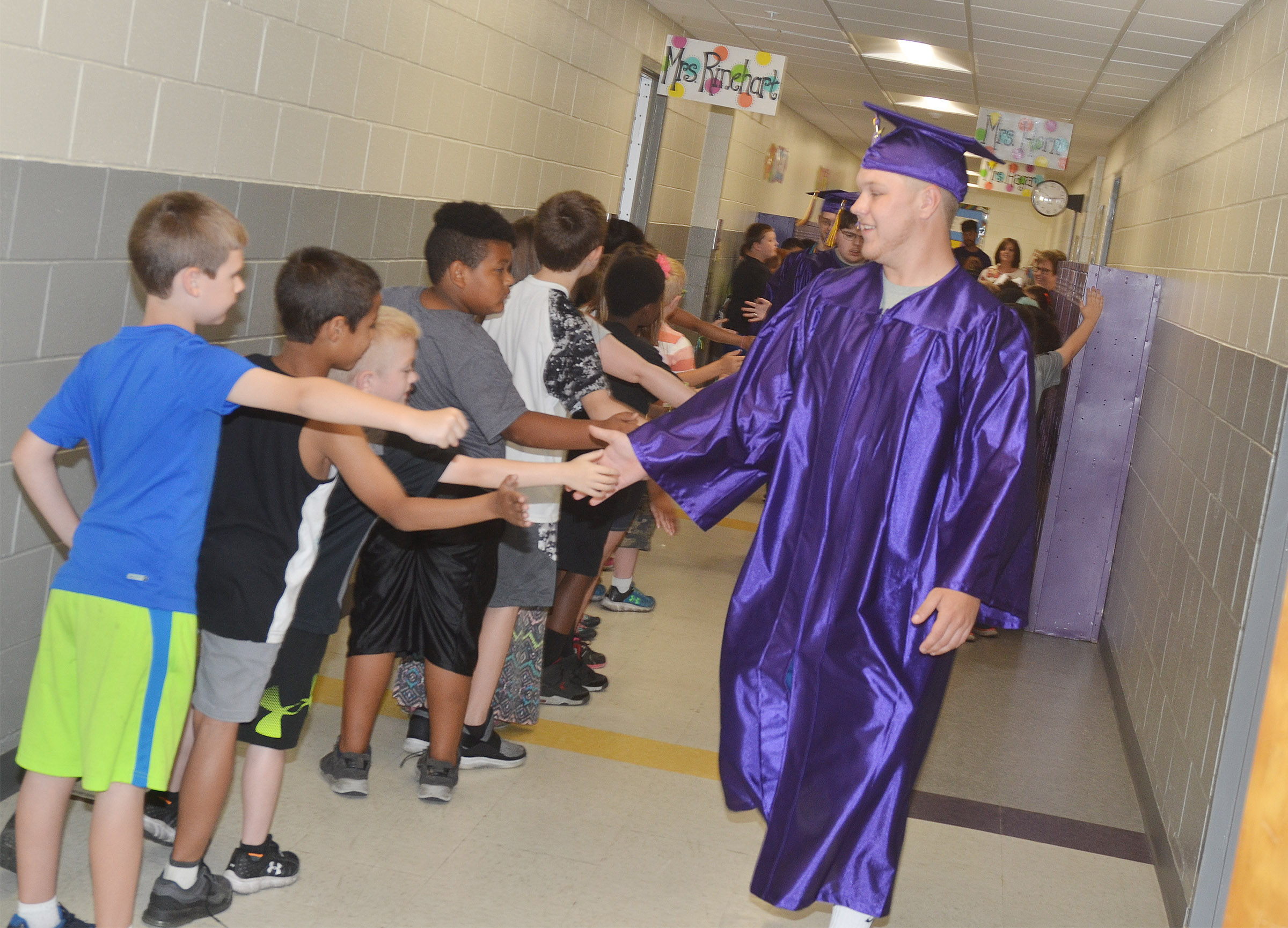 CHS senior Noah Wagers and his classmates walk down the hallways at CES.