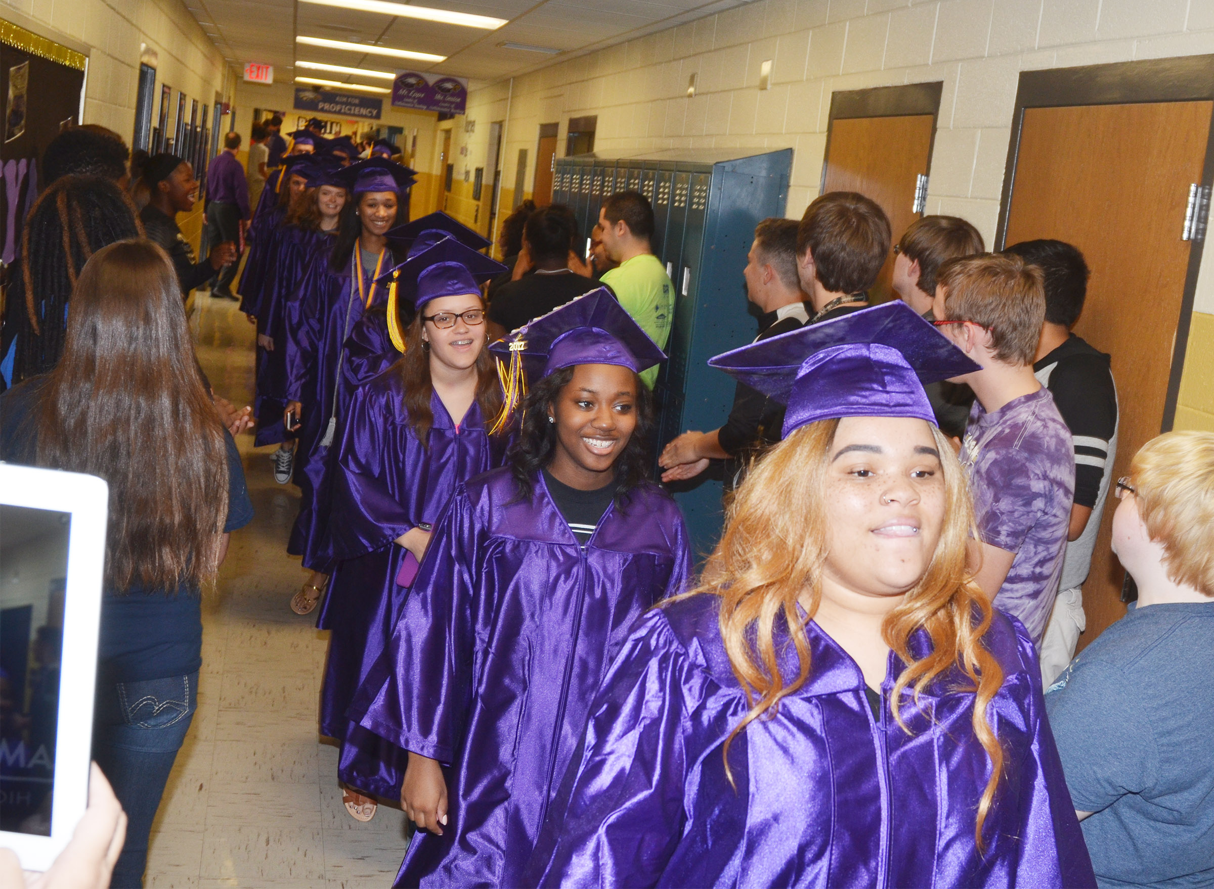 CHS seniors, from left, Breanna Spaulding, Latavia Shively and Deovion Owens walk with their classmates down the hallways at CHS.