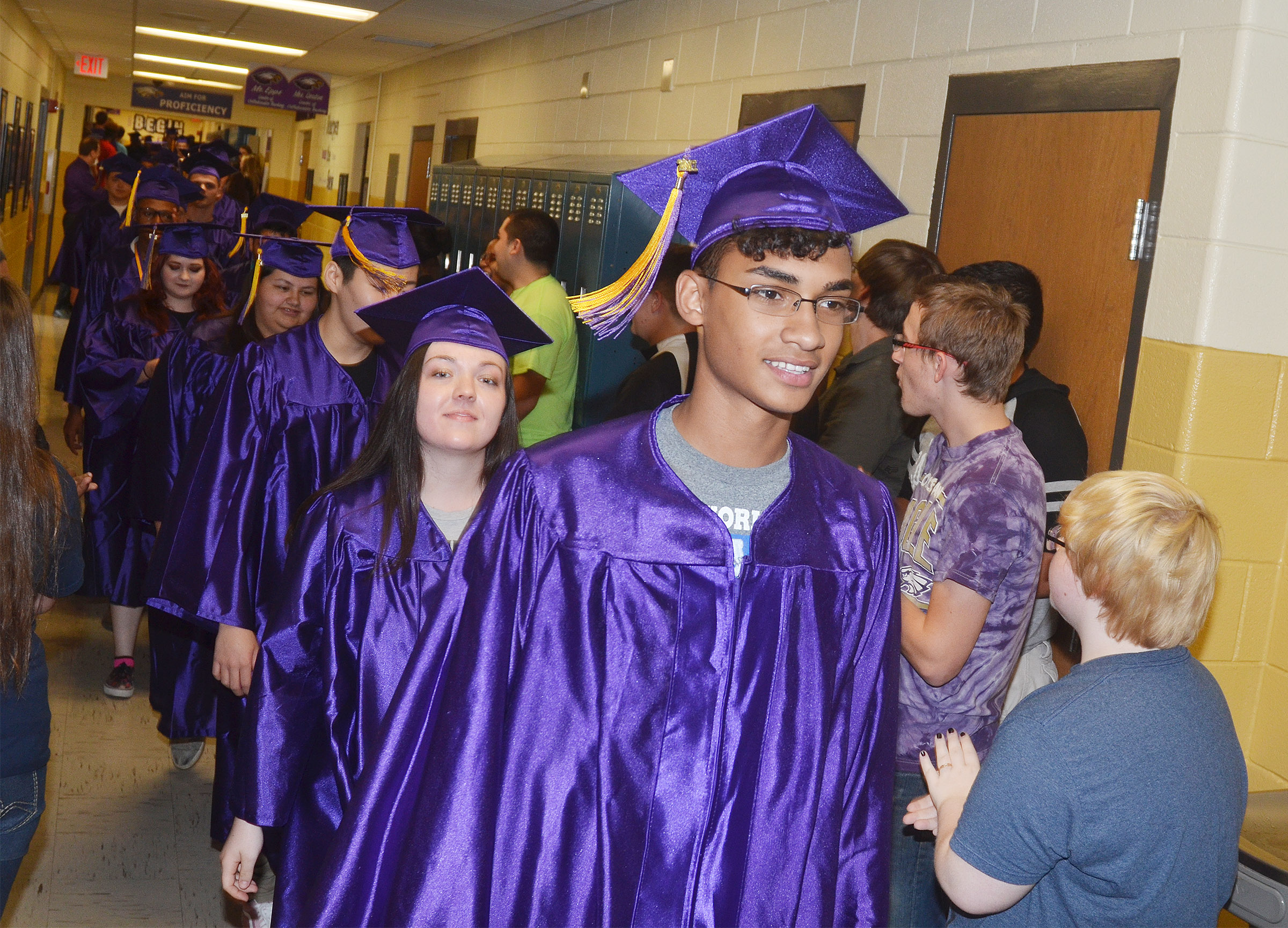 CHS senior Daniel Silva and his classmates walk down the hallways at CHS.