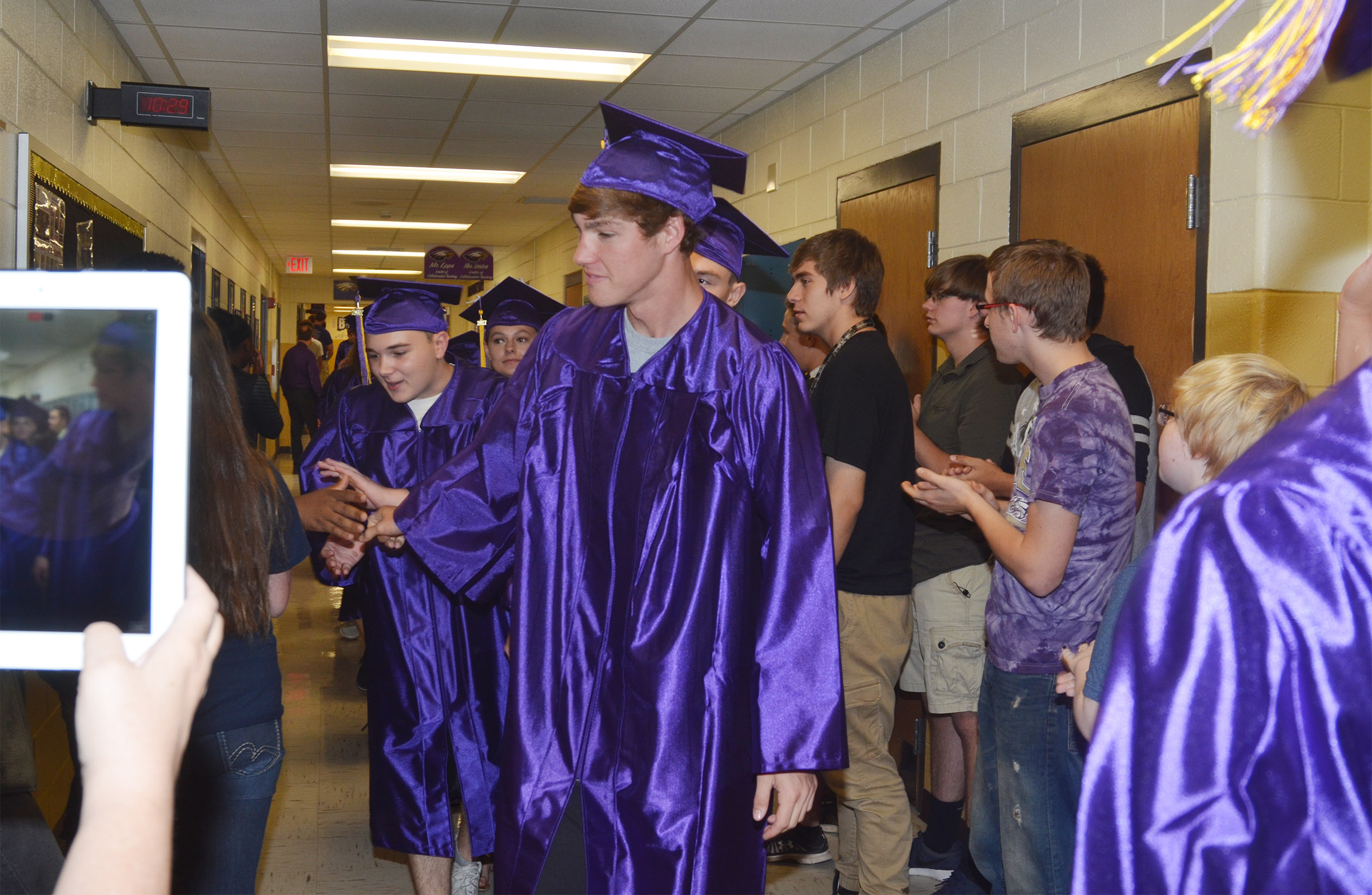 CHS senior Zack Bottoms walks down the CHS hallways with his classmates.