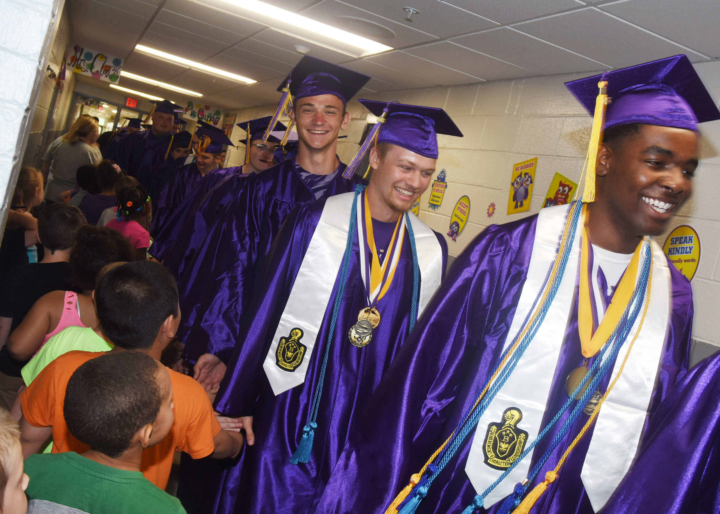From left, Connor Wilson, Wyatt Houk and Chanson Atkinson participate in the Senior Walk at CES.