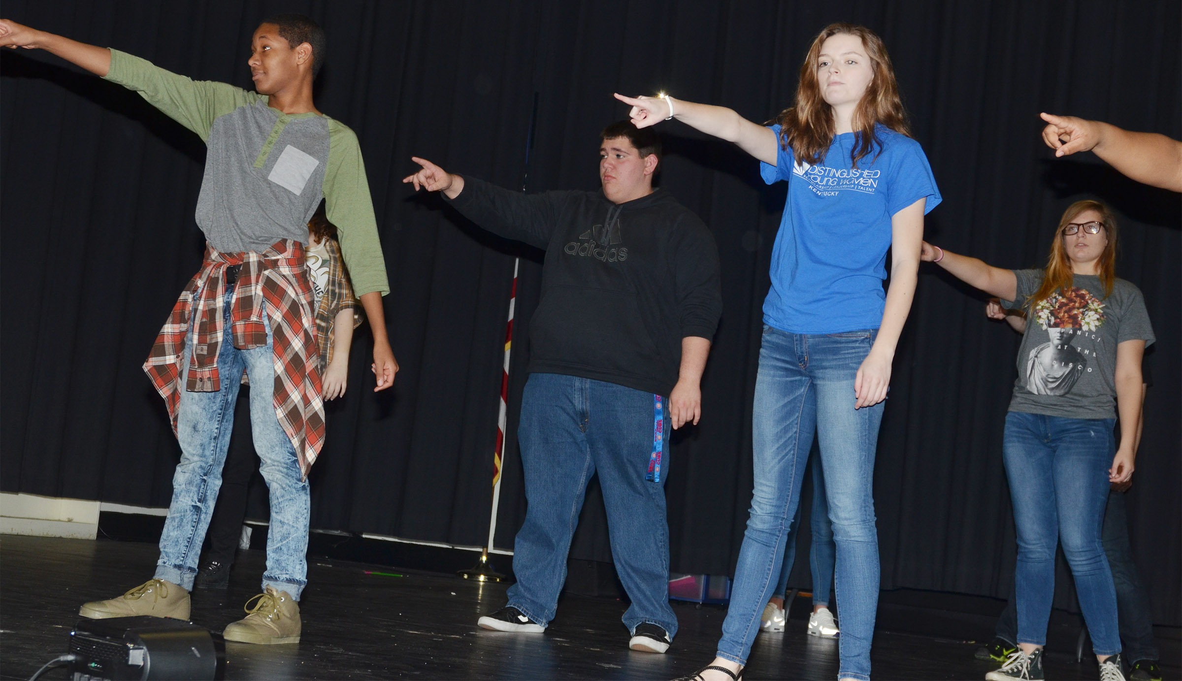 From left, CHS senior Jaleel Cowan, junior Ryan Wiedewitsch, senior Blair Lamb and junior Tiffany Kane dance during a recent show choir rehearsal.