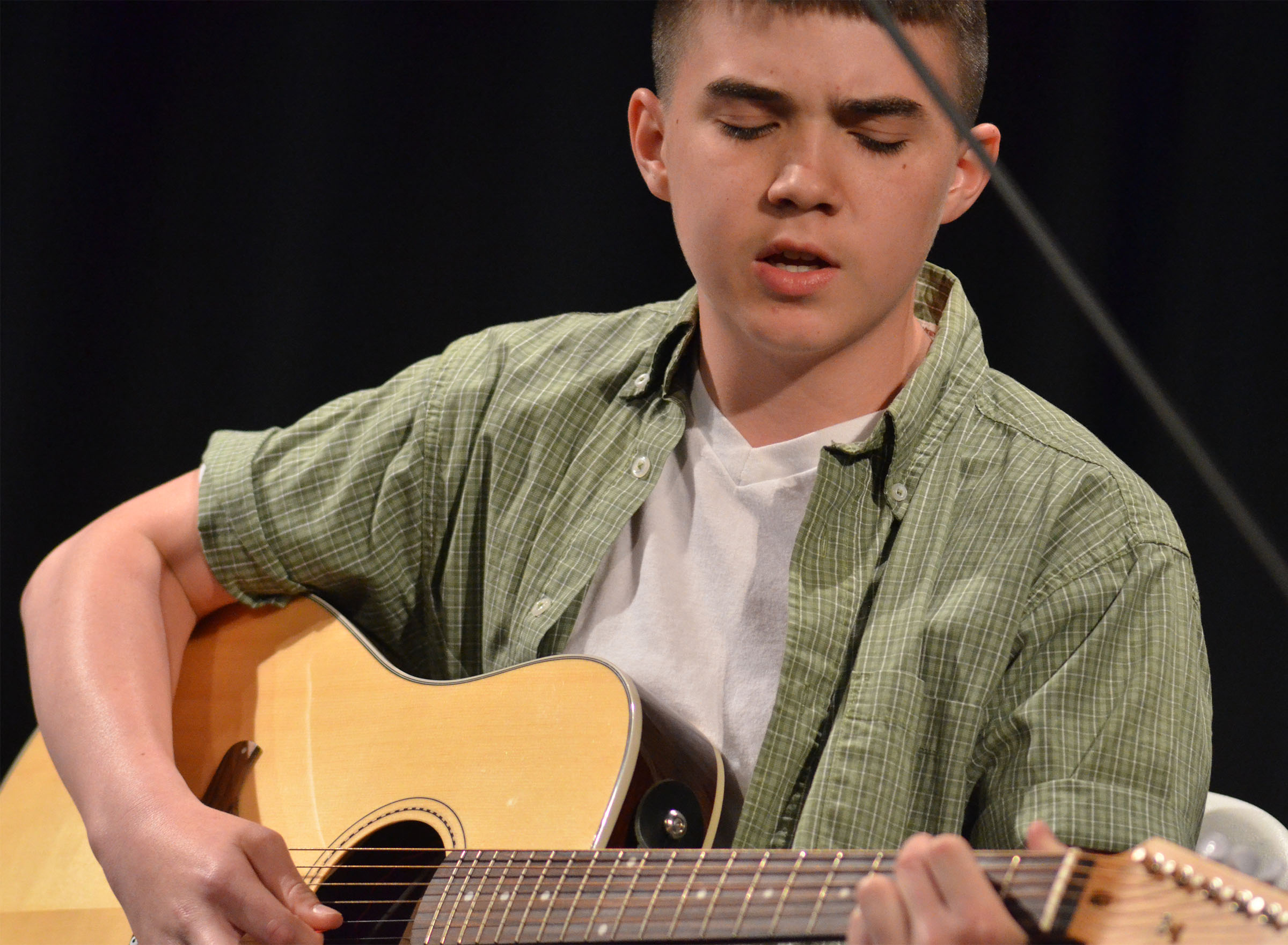 CHS freshman Cole Kidwell plays guitar and sings.