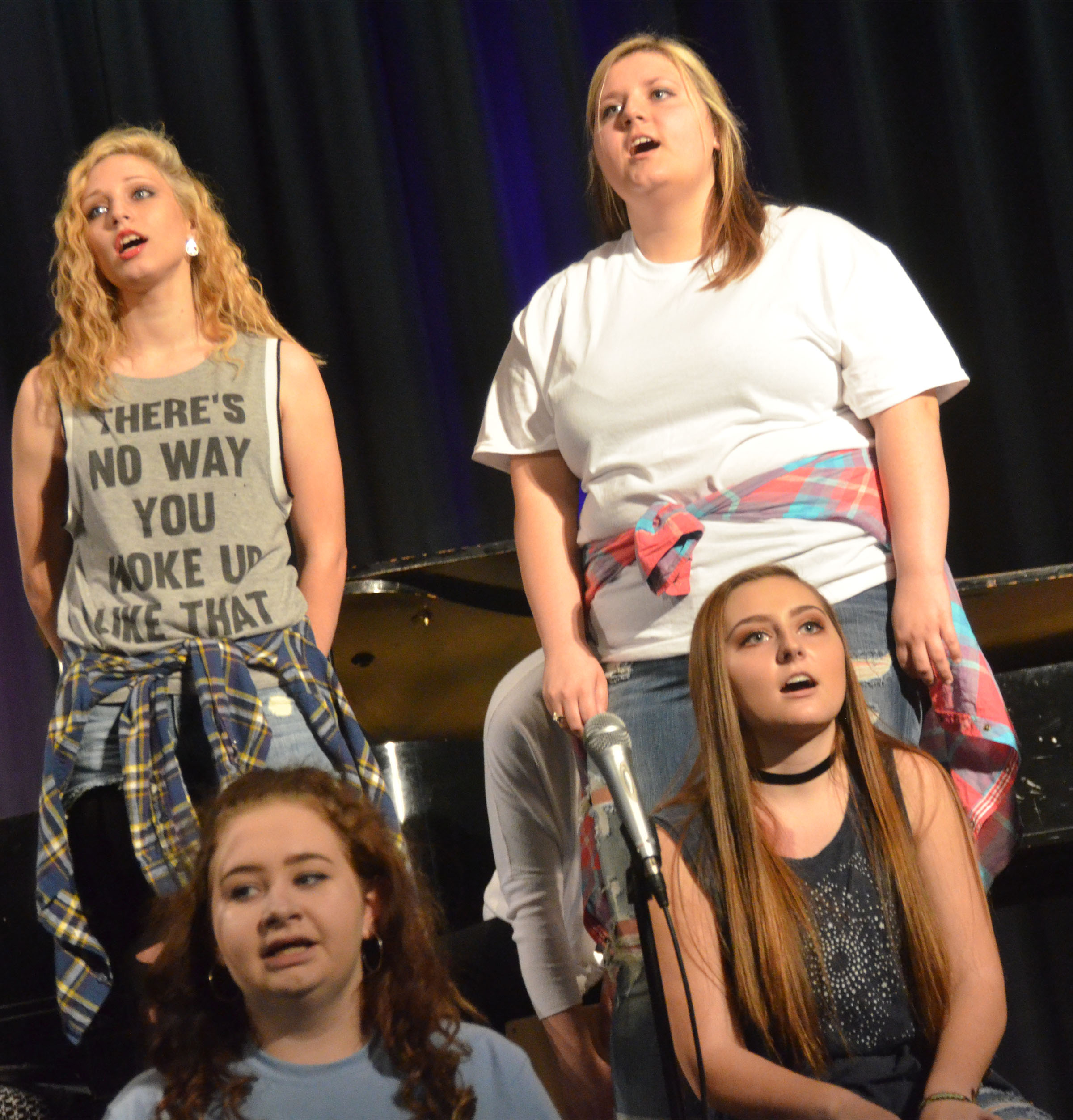 CHS show choir members perform. From left, front, are sophomores Leslie McKenzie and Reagan Knight. Back, junior Jasmine Coomer and sophomore Andrea Bryant.