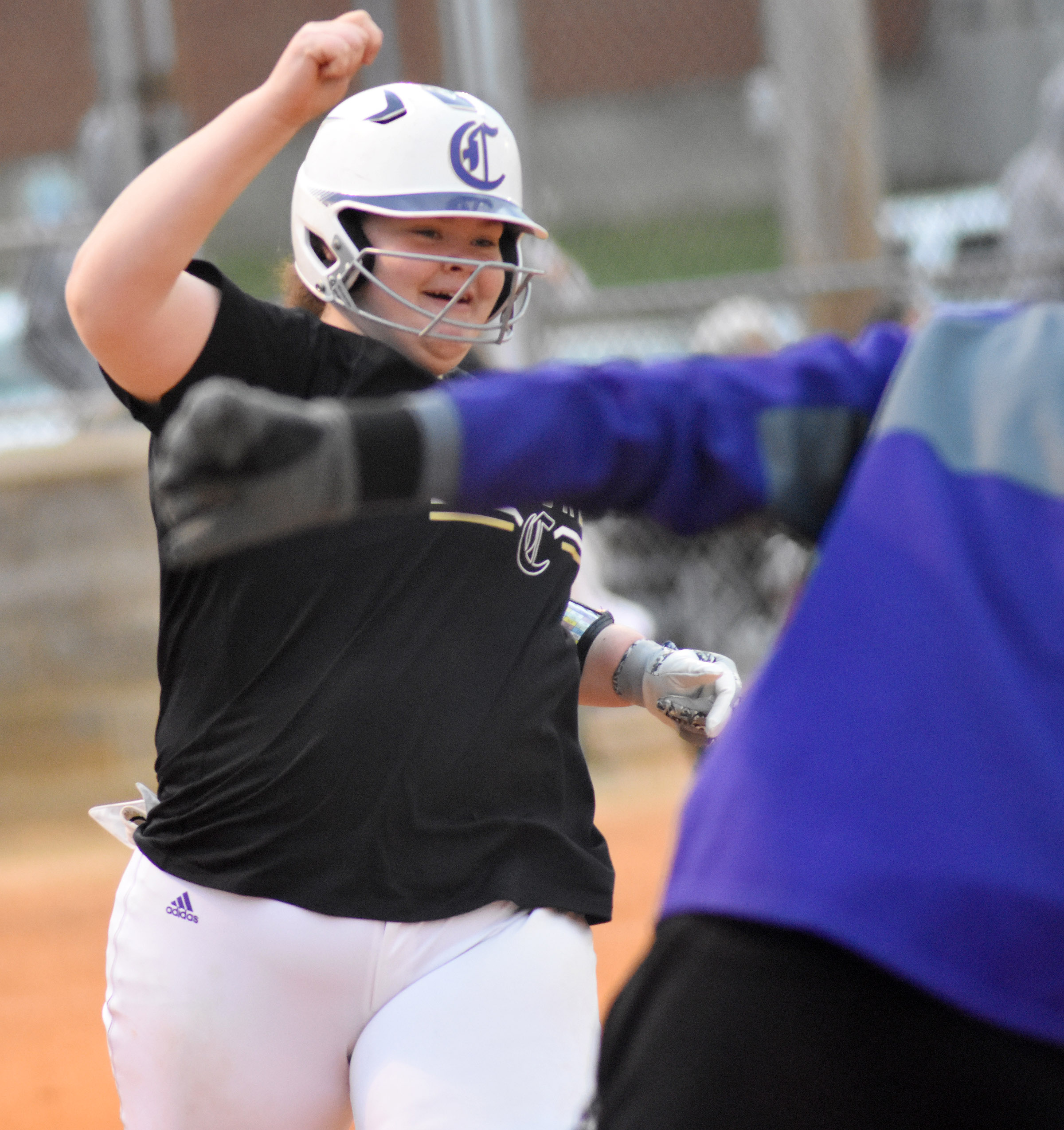 CHS sophomore Shallan Philpott smiles as she rounds the bases after hitting a home run.