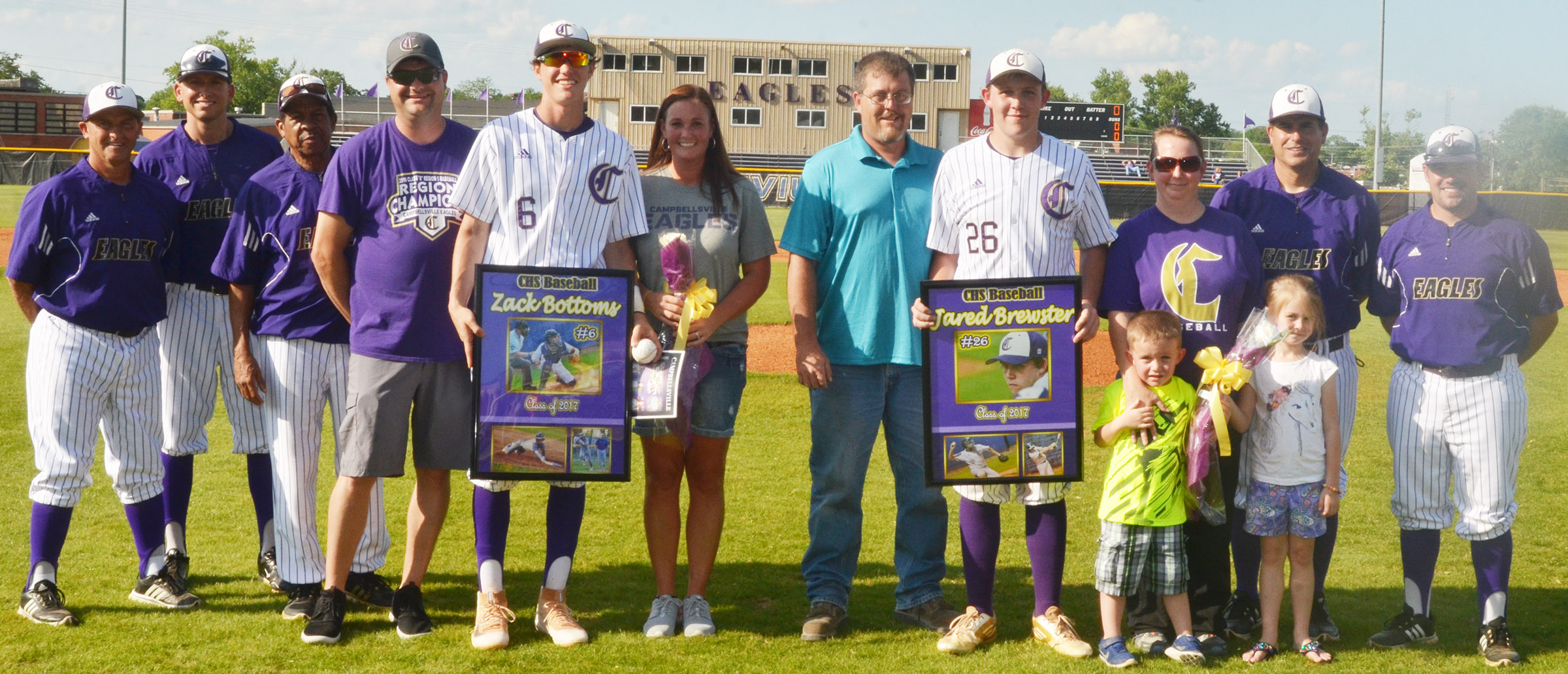 CHS seniors Zack Bottoms and Jared Brewster are honored for their dedication to the CHS baseball team. They are pictured with their families and coaches. From left are assistant coaches Lynn Kearney, Zach Lewis and Phil Gowdy, Bottoms's dad Adam, Bottoms, Bottoms's mother Kecia, Brewster's dad David, Brewster, Brewster's mother Suzanne Davis, Brewster's siblings Jaden and Jewell, head coach Kirby Smith and assistant coach Blake Milby.