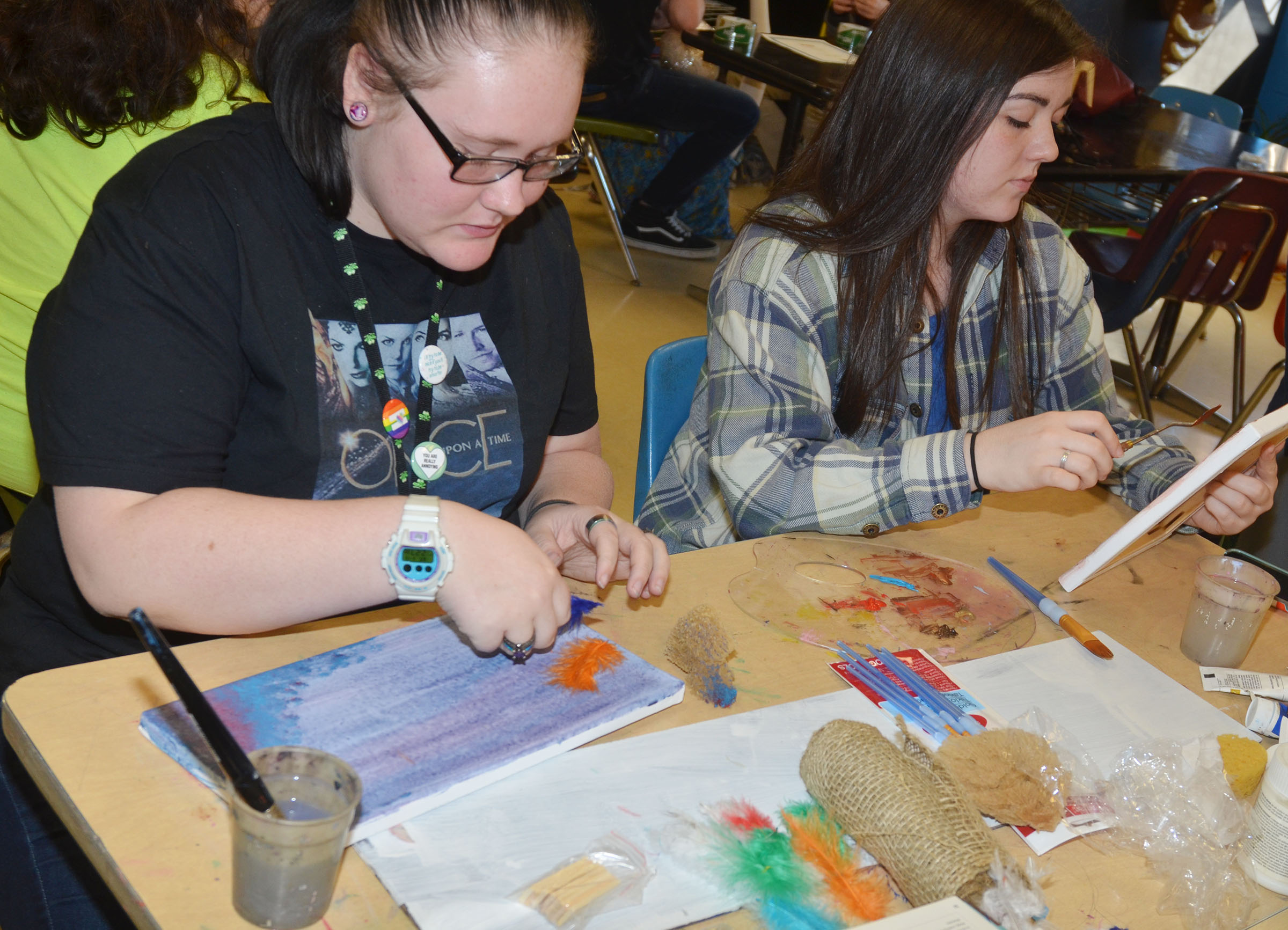 CHS specialized art students Jasmine Cox, at let, a junior, and senior Tiffany Stagner practice creating art with texture.