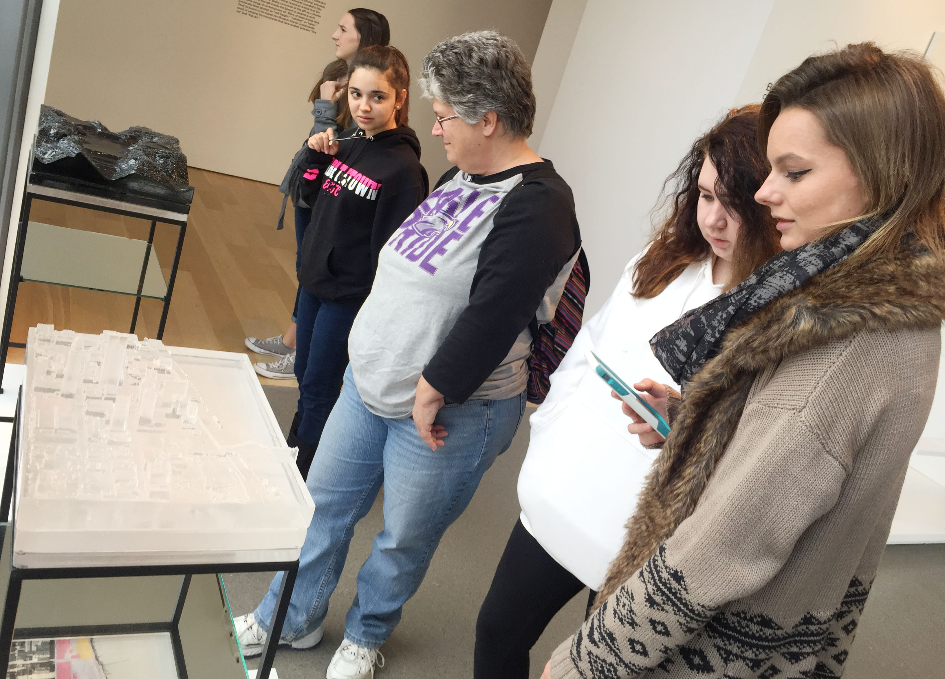 CHS sophomores, from left, Chloe Decker, Jessie Bennett and Christina Phipps look around the sneaker exhibit.