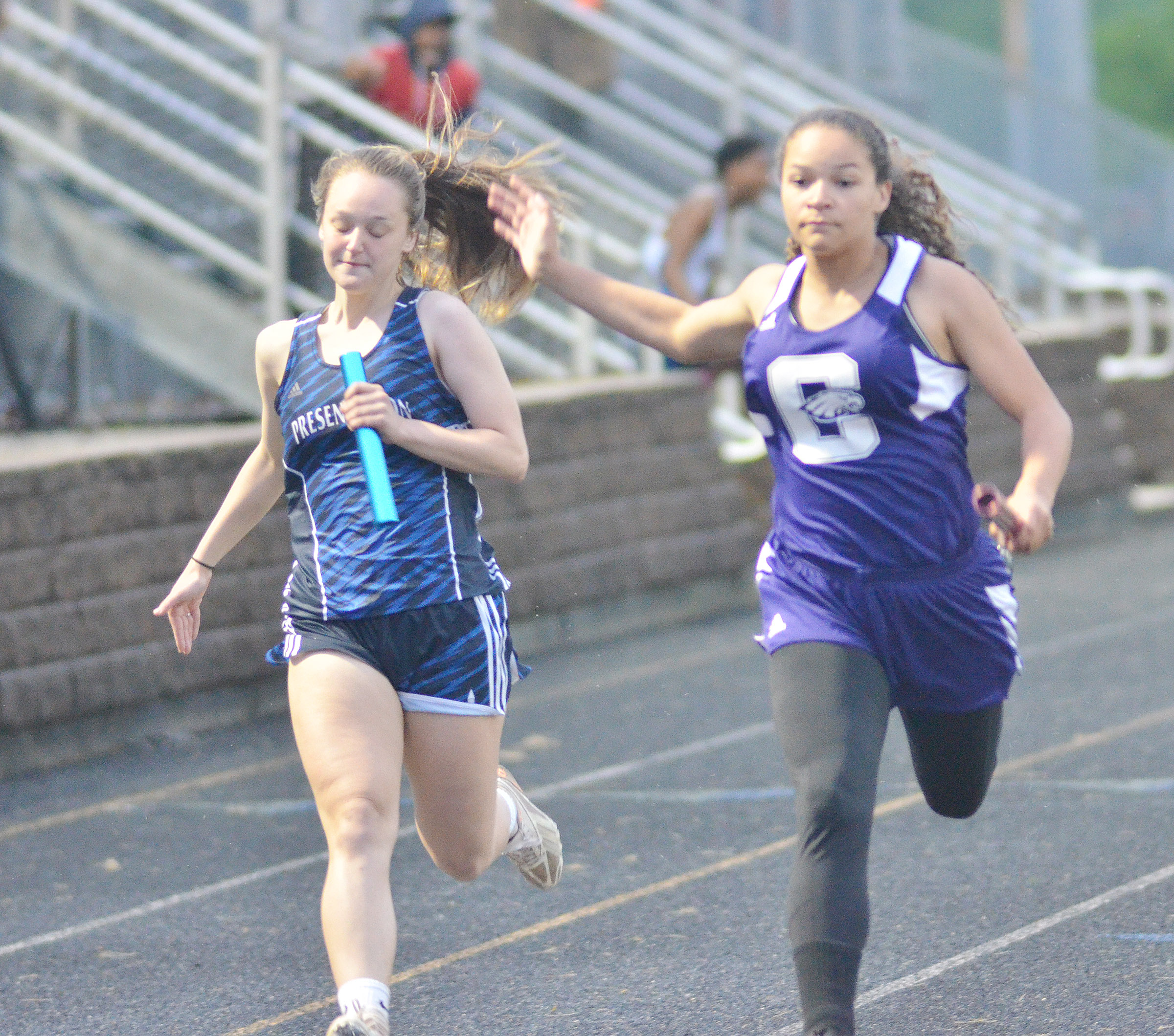 CHS freshman Taliyah Hazelwood finished second in the 200-meter dash at region competition, above, which qualified her to compete at this year's state meet. She finished fifth and set a personal record at 26.77 seconds.