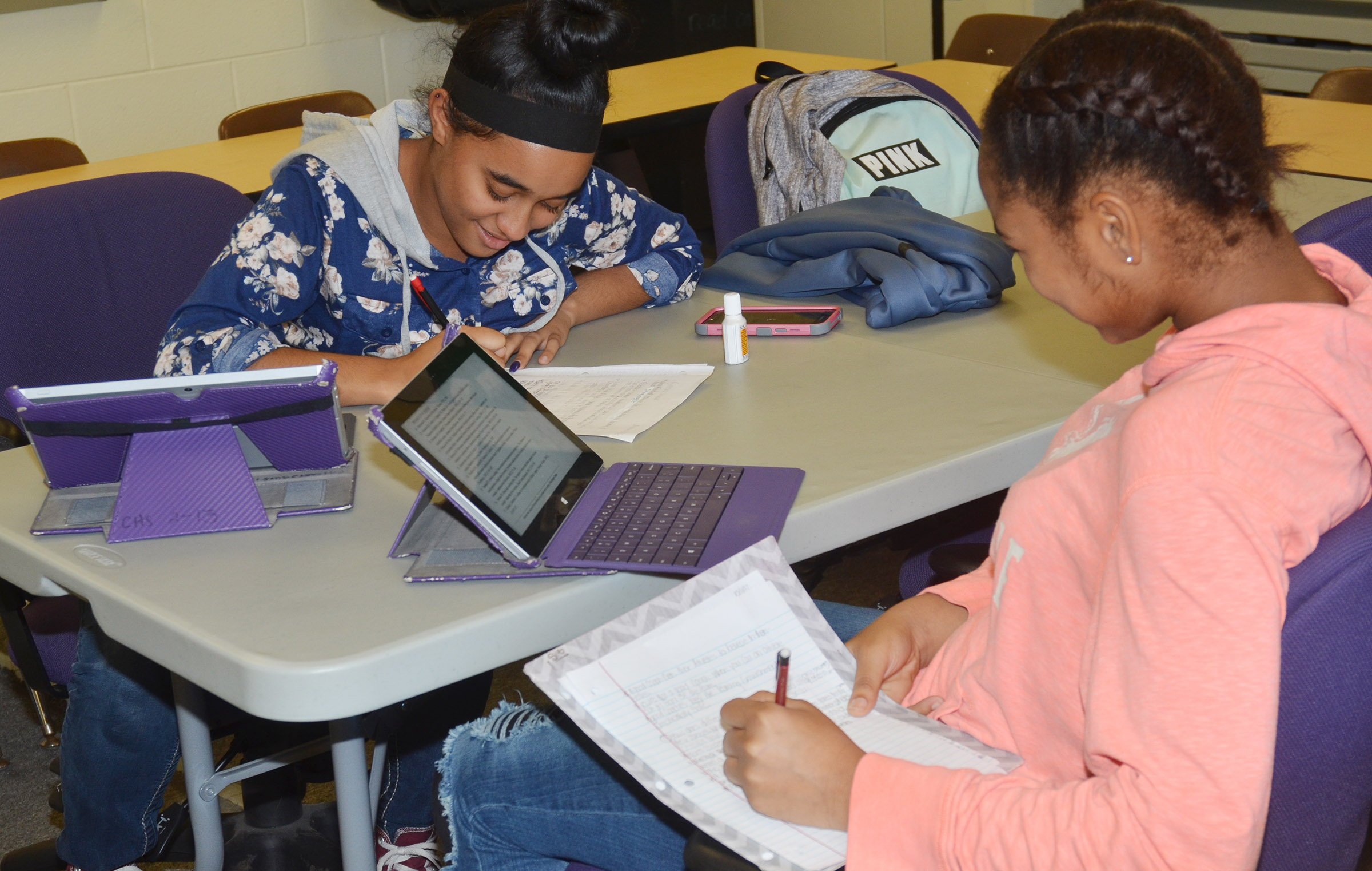 CHS sophomore Jasmine Coro, at left, and Isis Coleman work on a project for their English class.
