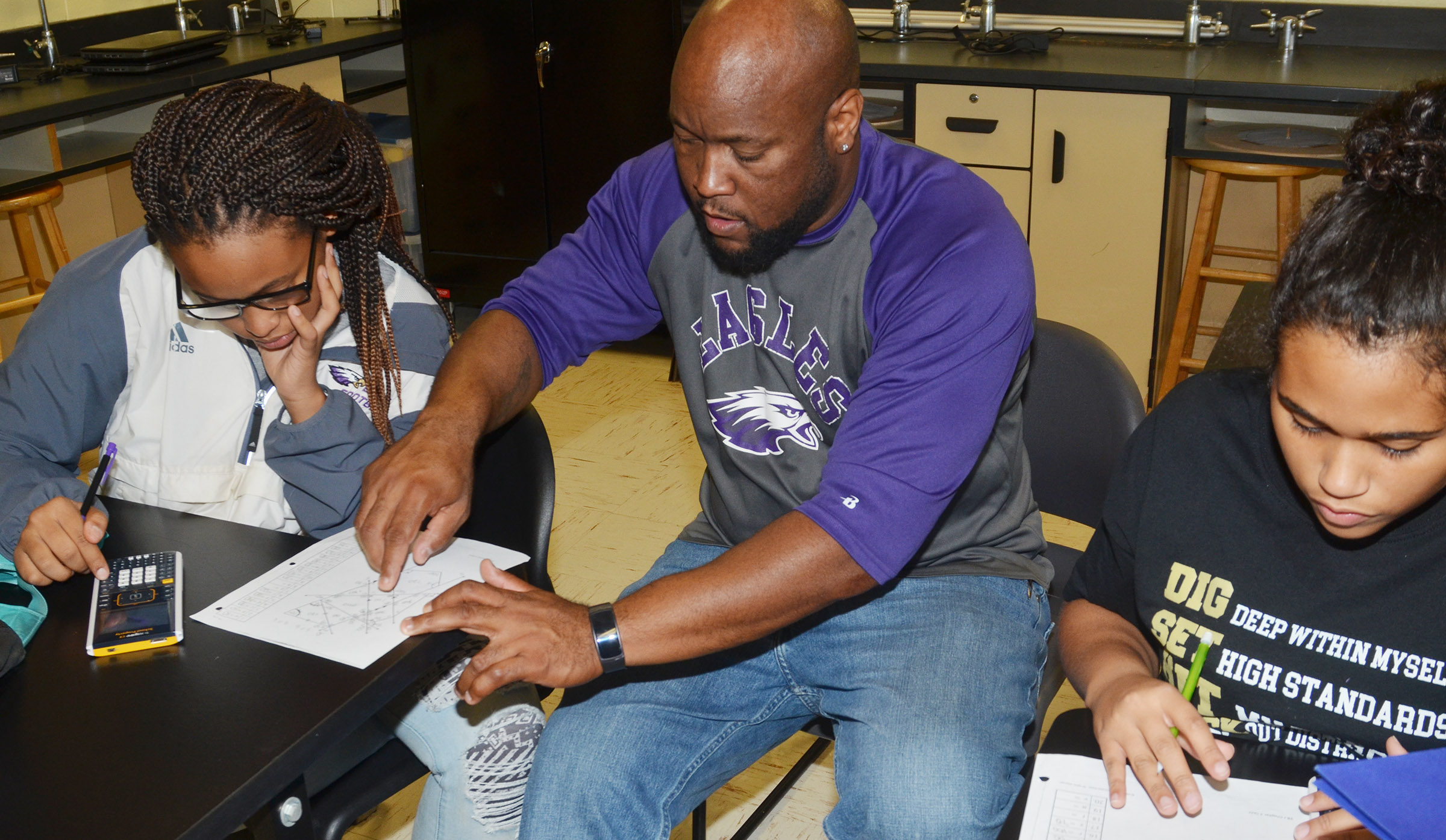 CHS special education teacher Anthony Epps, helps, sophomores Ketayah Taylor, at left, and Siera Owens with their homework.