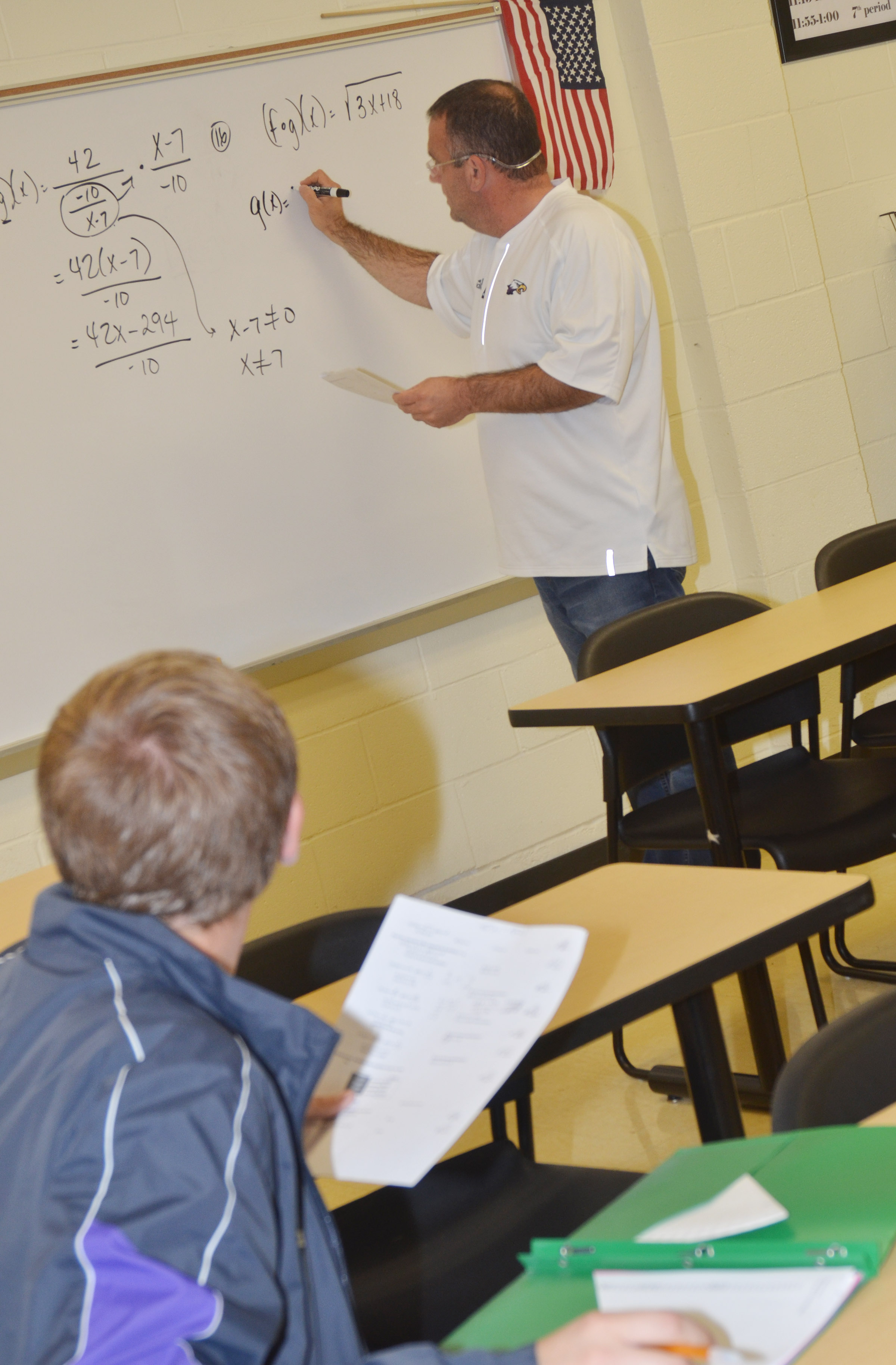 CHS teacher Kevin Rafferty works a math problem for junior Brandon Greer and his classmates.
