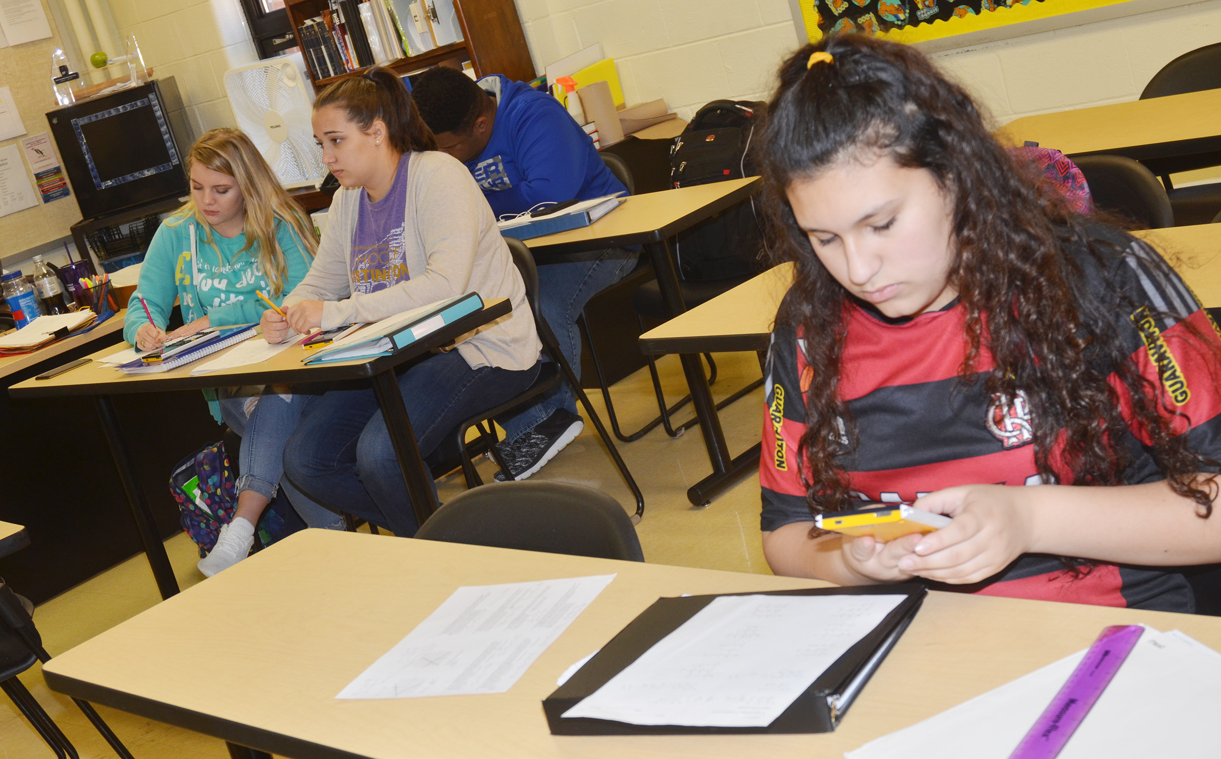 From left, CHS juniors Hayley Stapleton, Elizabeth Sullivan and Jeremiah Jackson and freshman Anna Clara Moura work to complete some math problems.