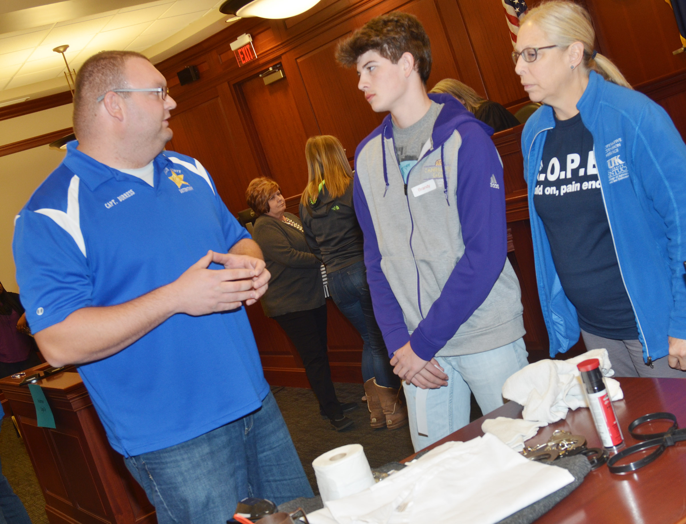 "CHS freshman Mark Rigsby and his ""mother"" Angie Freeman of the Taylor County Extension Office talk with Taylor County Detention Center Captain Adam Burress as part of the ""Truth or Consequences"" scenario."