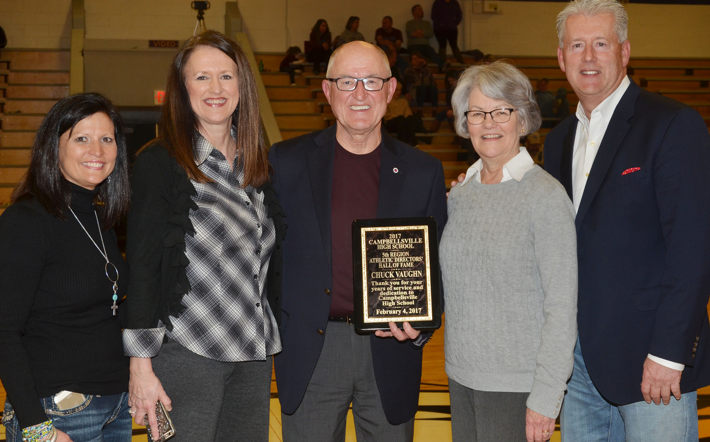 Chuck Vaughn, former Campbellsville Independent Schools superintendent, was inducted into the 5th Region Athletic Director's Hall of Fame on Saturday, Feb. 4. He was honored during the CHS boys' basketball game versus Metcalfe County. From left are his sister-in-law June Vaughn, his sister Karen Hayes, Vaughn, his wife Karen and his brother Denny Vaughn.