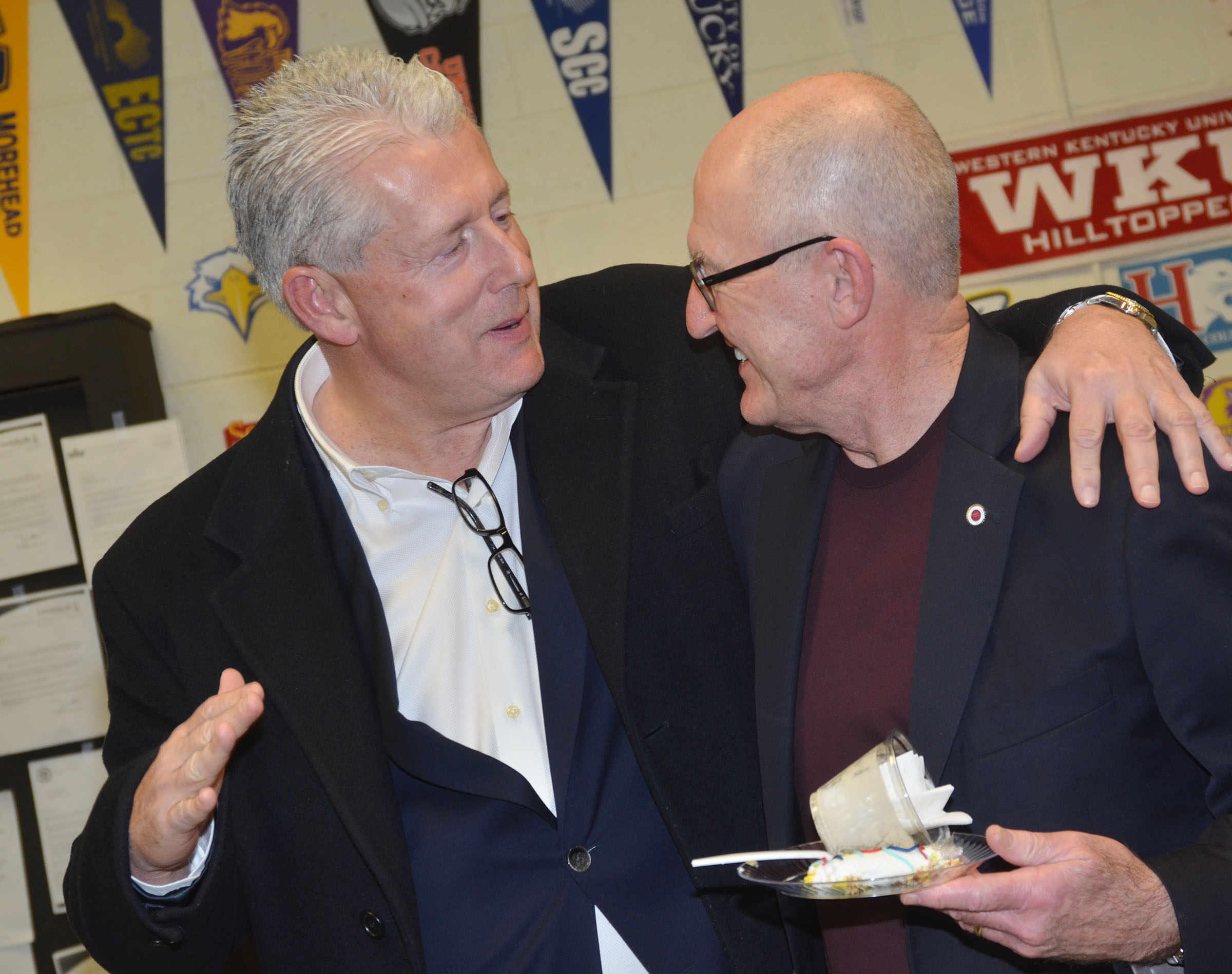 Chuck Vaughn, former Campbellsville Independent Schools superintendent, was inducted into the 5th Region Athletic Director's Hall of Fame on Saturday, Feb. 4. He was honored during the CHS boys' basketball game versus Metcalfe County and then at a reception. Above, Vaughn, at right, talks with his brother Denny Vaughn.