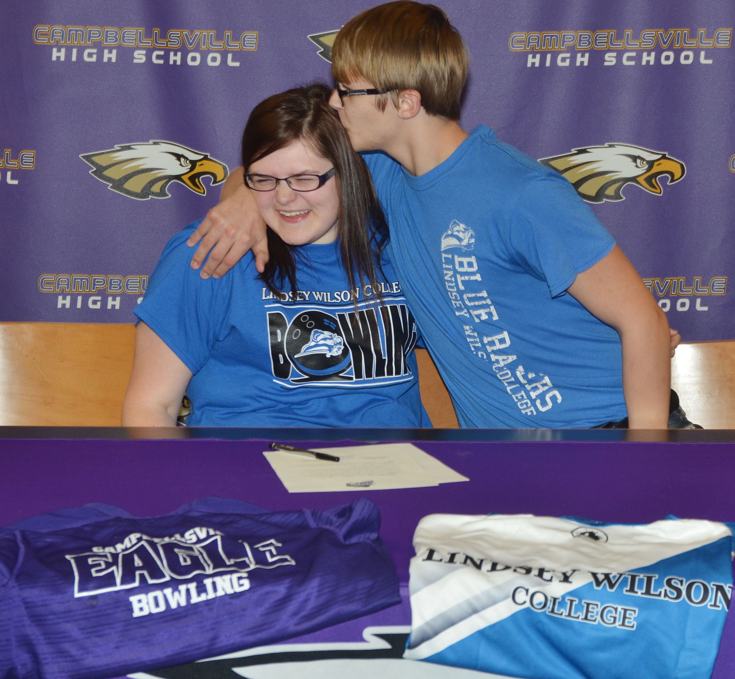 Campbellsville High School senior Vera Brown will continue her academic and bowling career at Lindsey Wilson College in the fall. She officially signed her letter of intent in a special ceremony on Wednesday, Feb. 1. Above, she receives a hug and kiss from her brother, CHS freshman Dalton Brown.