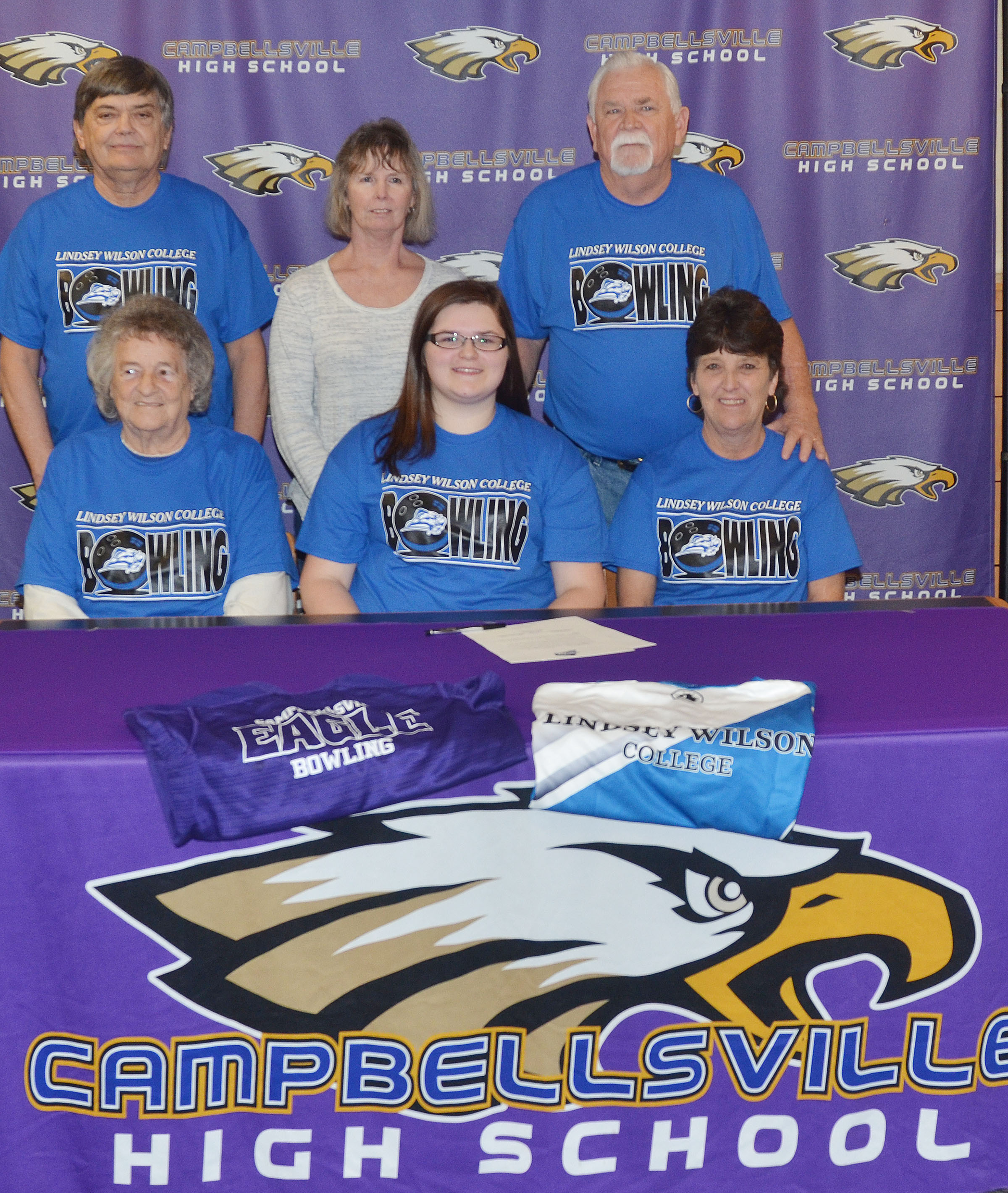 Campbellsville High School senior Vera Brown will continue her academic and bowling career at Lindsey Wilson College in the fall. She officially signed her letter of intent in a special ceremony on Wednesday, Feb. 1. From left, front, are great-grandmother Juanita Skaggs, Vera and grandmother Sandy Holmes. Back, grandfather David Zirnheld, grandmother LouAnn Zirnheld and grandfather Allen Holmes.