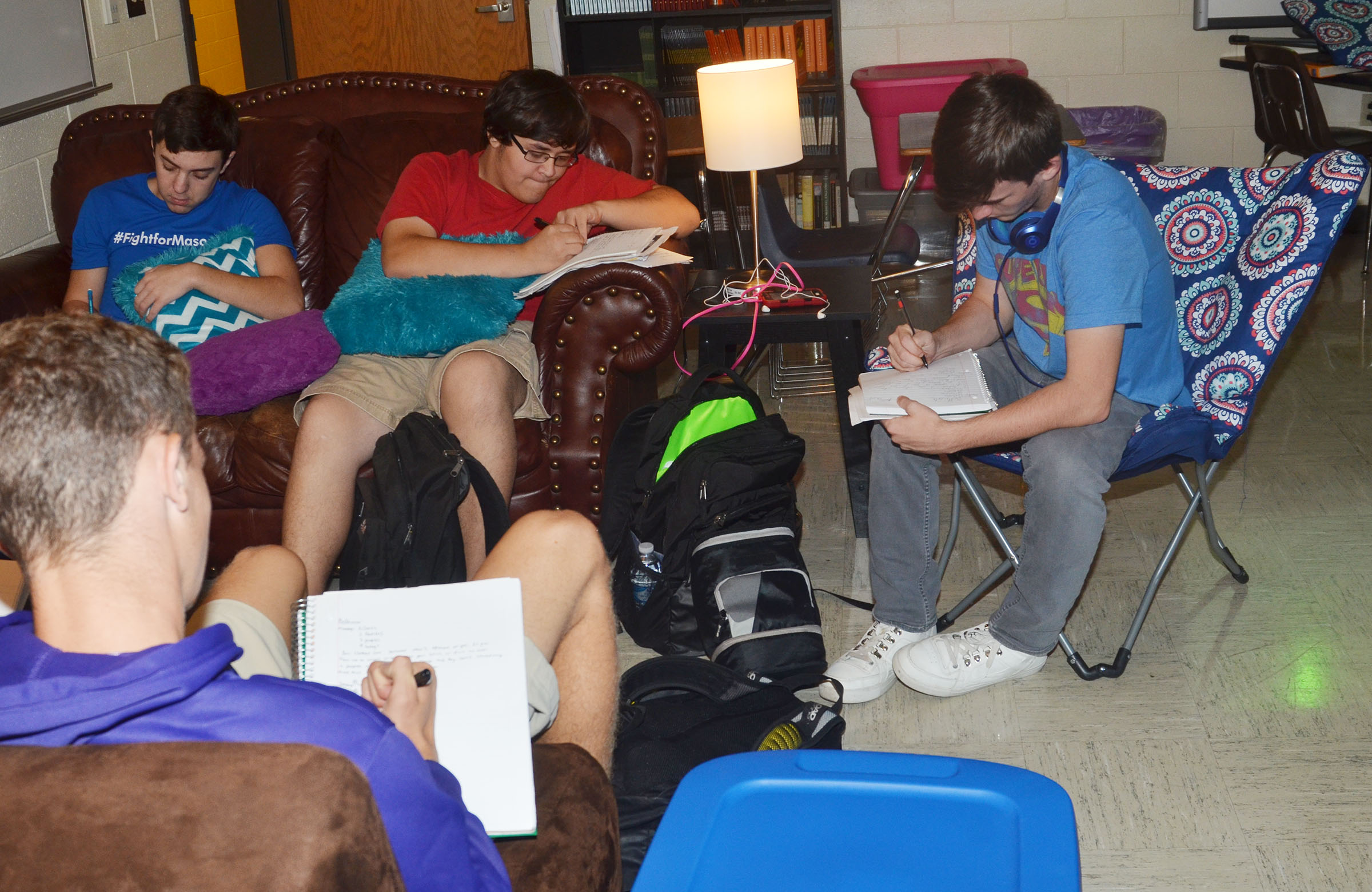 CHS juniors, from left, Jeremy Rainwater, Aidan McMahan and Jackson Hunt take notes in Lindsay Williams's class while sitting in her new couches. In the foreground is junior Connor Wilson.