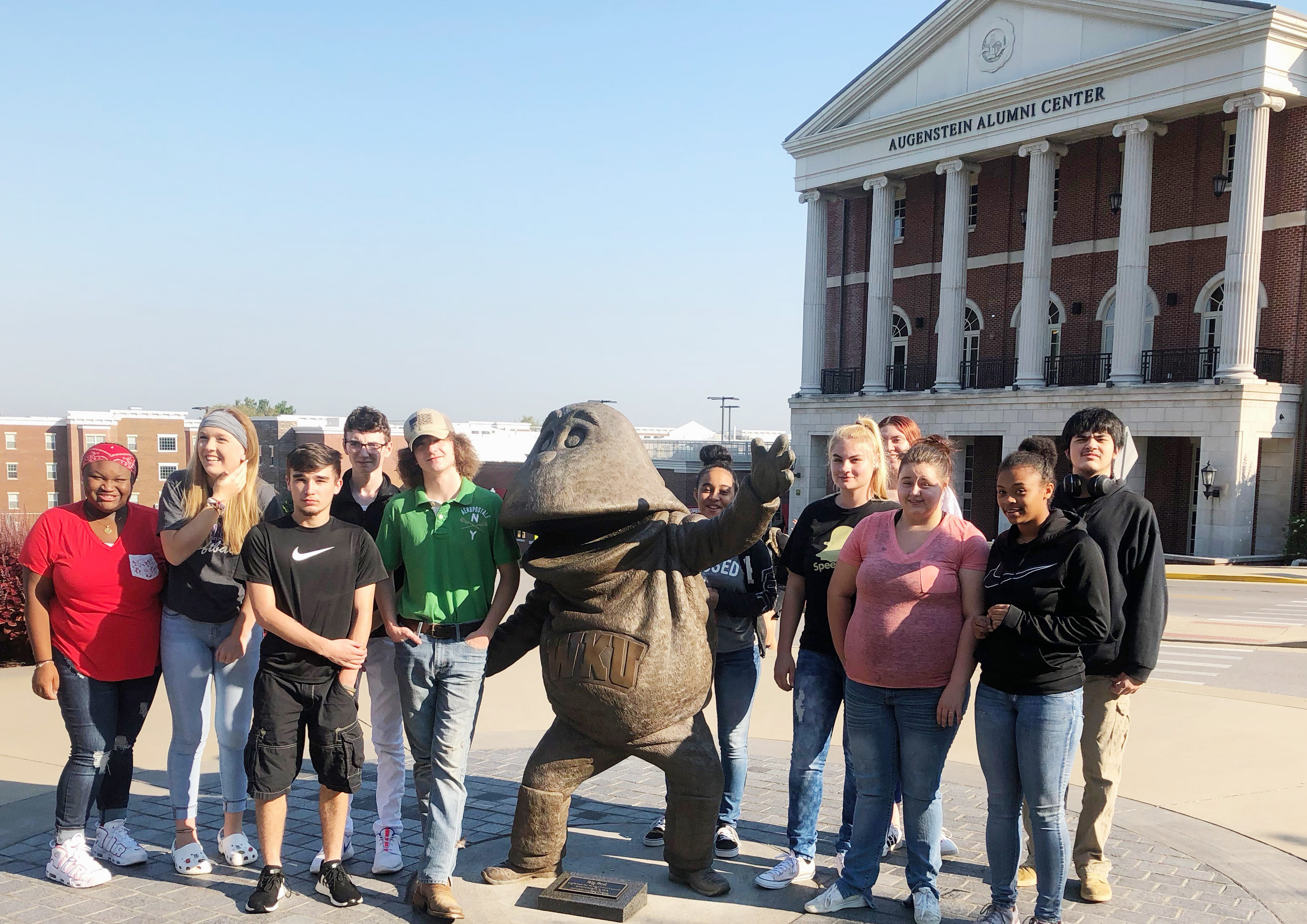 CHS students recently took a tour of the Western Kentucky University campus, and met mascot Big Red. From left are junior Ashalique Adams, sophomore Catlyn Clausen, senior Skyler Burchett, sophomore Jonathan Sparks, senior Merick Turner, junior Jasmine Coro, sophomore Samantha Underwood, junior Danielle Shimek, senior Amanda Dotson, junior Alexis Lane and senior Seth Tindal.