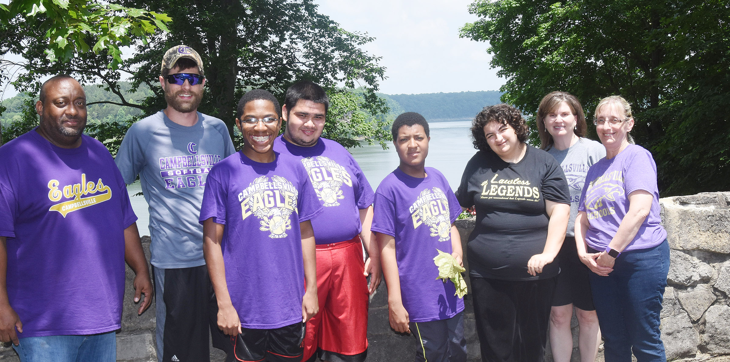 From left, CHS instructional assistants Joseph Taylor and Matthew Schmuck, junior Travis Nash, senior Robert Tungate, juniors Chris Moran and Brooke Tucker, Community Based Work Transition Program Coordinator Wendy Sabo and exceptional child educator Juanita Young pose for a photo together in front of Green River Lake.