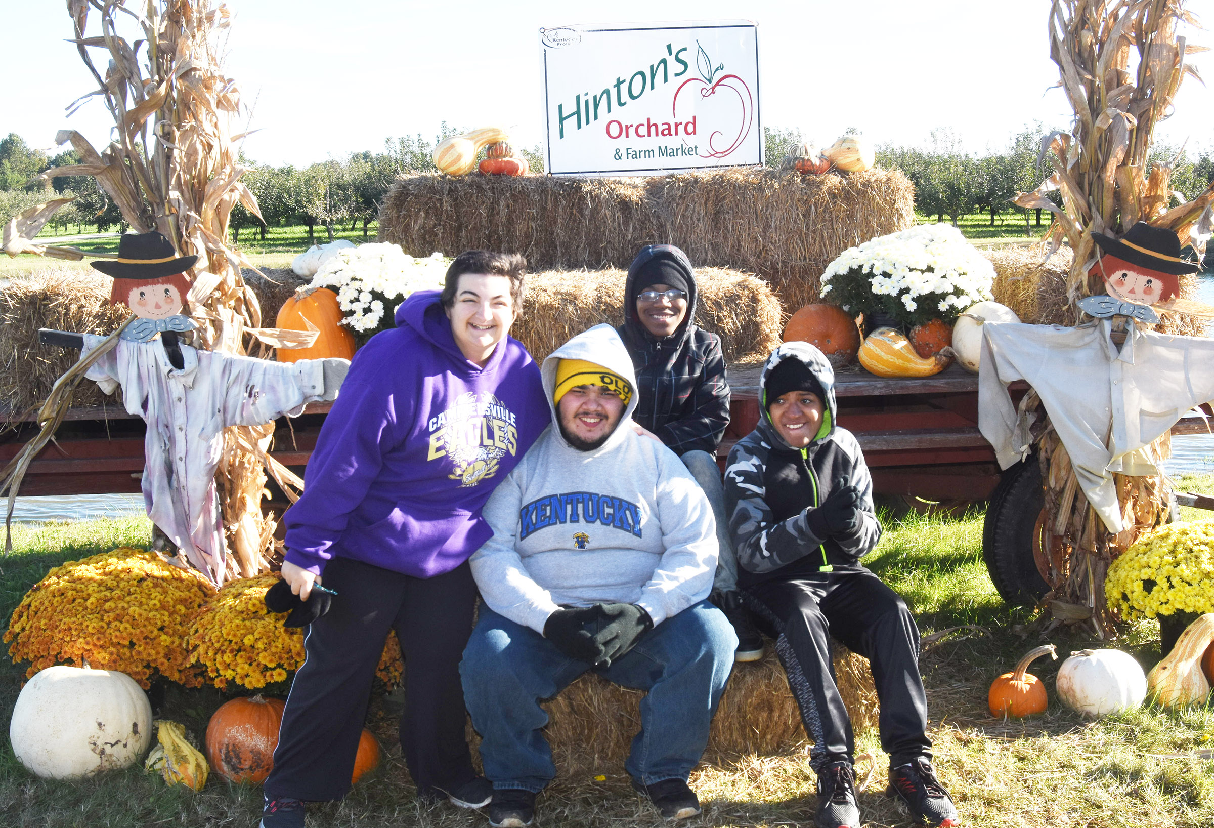 From left, CHS seniors Brooke Tucker, Robert Tungate, Travis Nash and Chris Moran smile for a photo together at Hinton's Orchard.