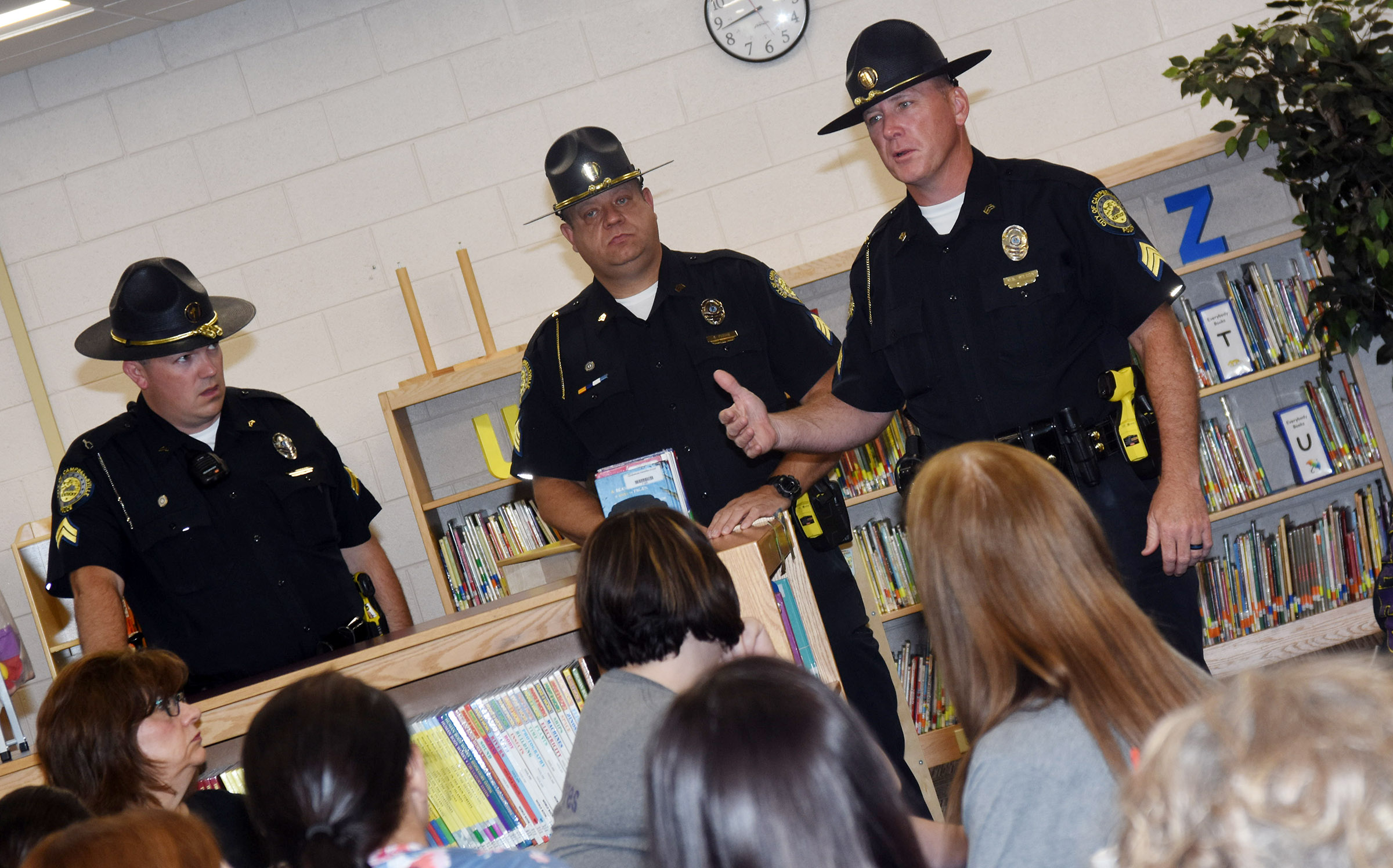 Campbellsville Independent Schools' staff members underwent active shooter training recently with Campbellsville Police officers. Above, from left, Brian Morgan, Scotty Perian and Shannon Wilson talk to CES staff members.