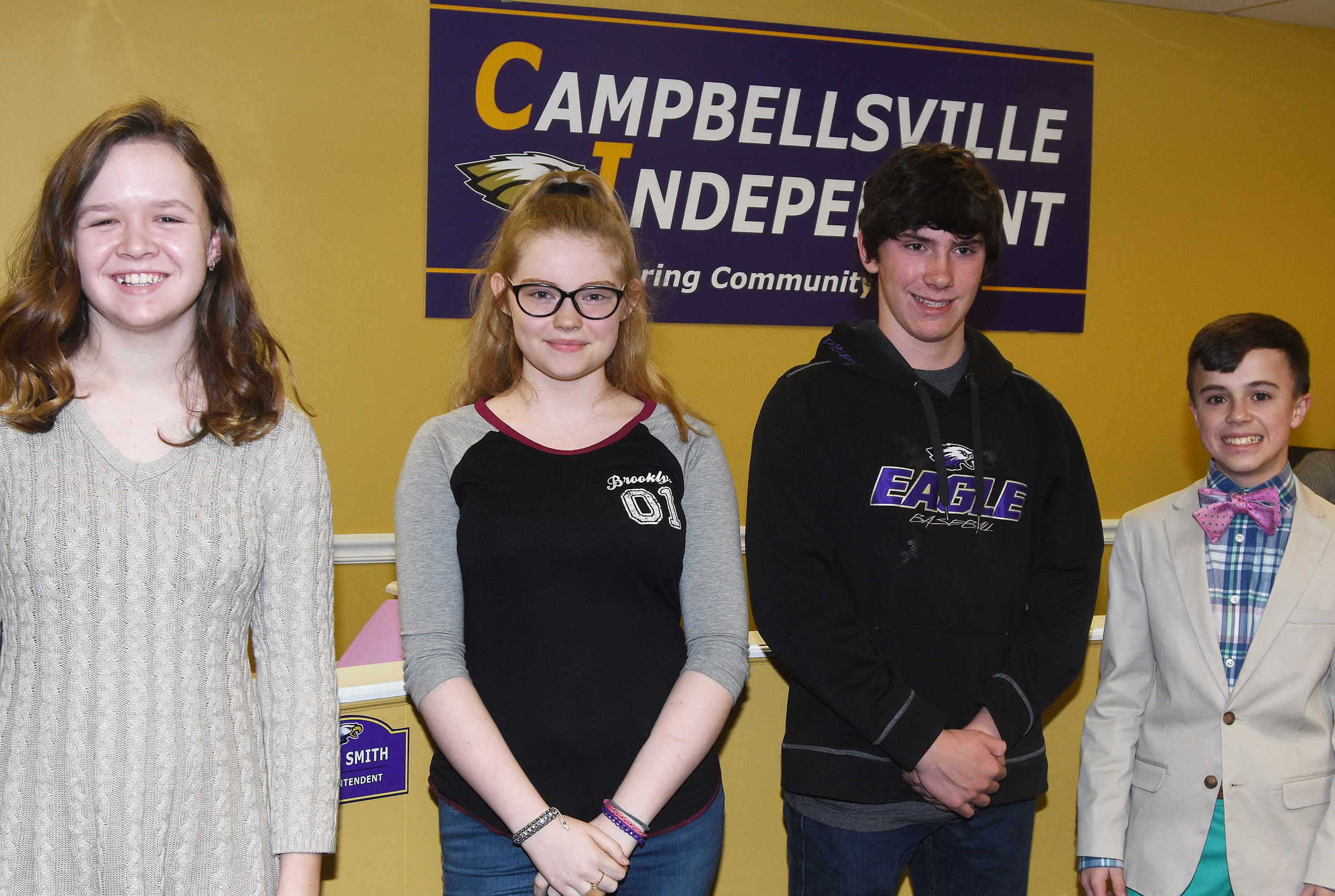 From left, CMS seventh-graders MaCayla Falls and Whitney Frashure, eighth-grader Peyton Dabney and seventh-grader Chase Hord are recognized at the Board of Education meeting on Monday, Feb. 12, for their recent academic team and Beta successes.