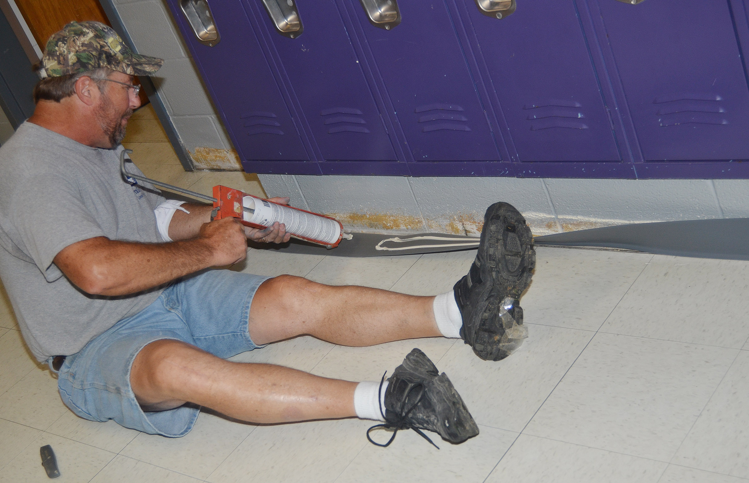 Chuck White, who works in maintenance, prepares the hallways at CES.