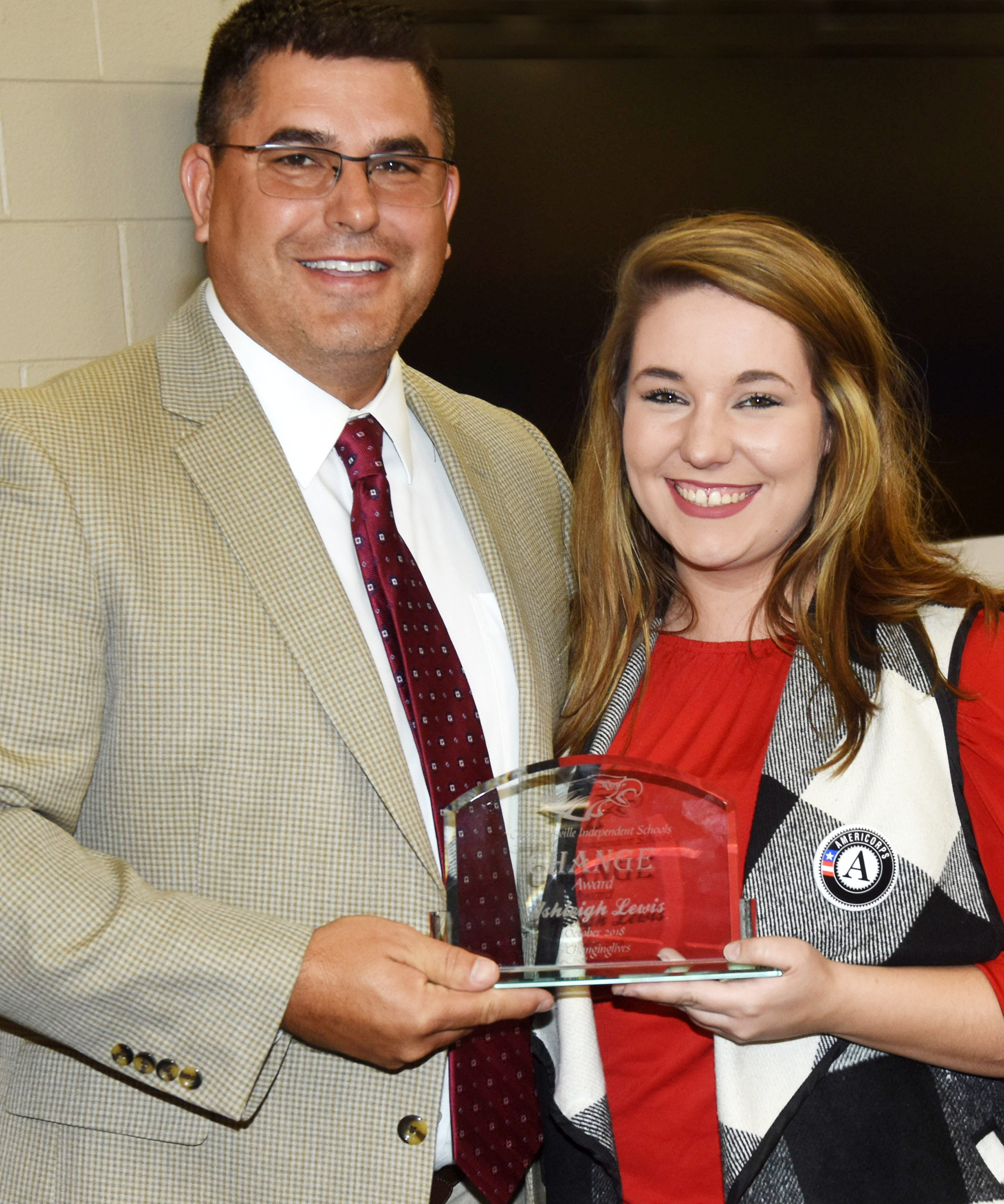 Campbellsville Independent Schools Superintendent Kirby Smith honors Campbellsville Independent Schools AmeriCorps reading tutor Ashleigh Lewis with the classified Change Award.