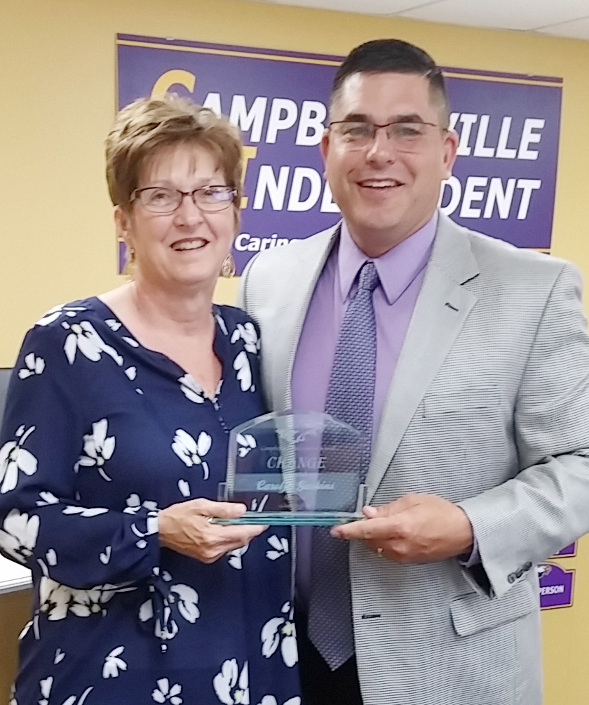 Campbellsville Independent Schools Superintendent Kirby Smith, at left, honors CMS instructional assistant Carolyn Gaskins with the classified Change Award.