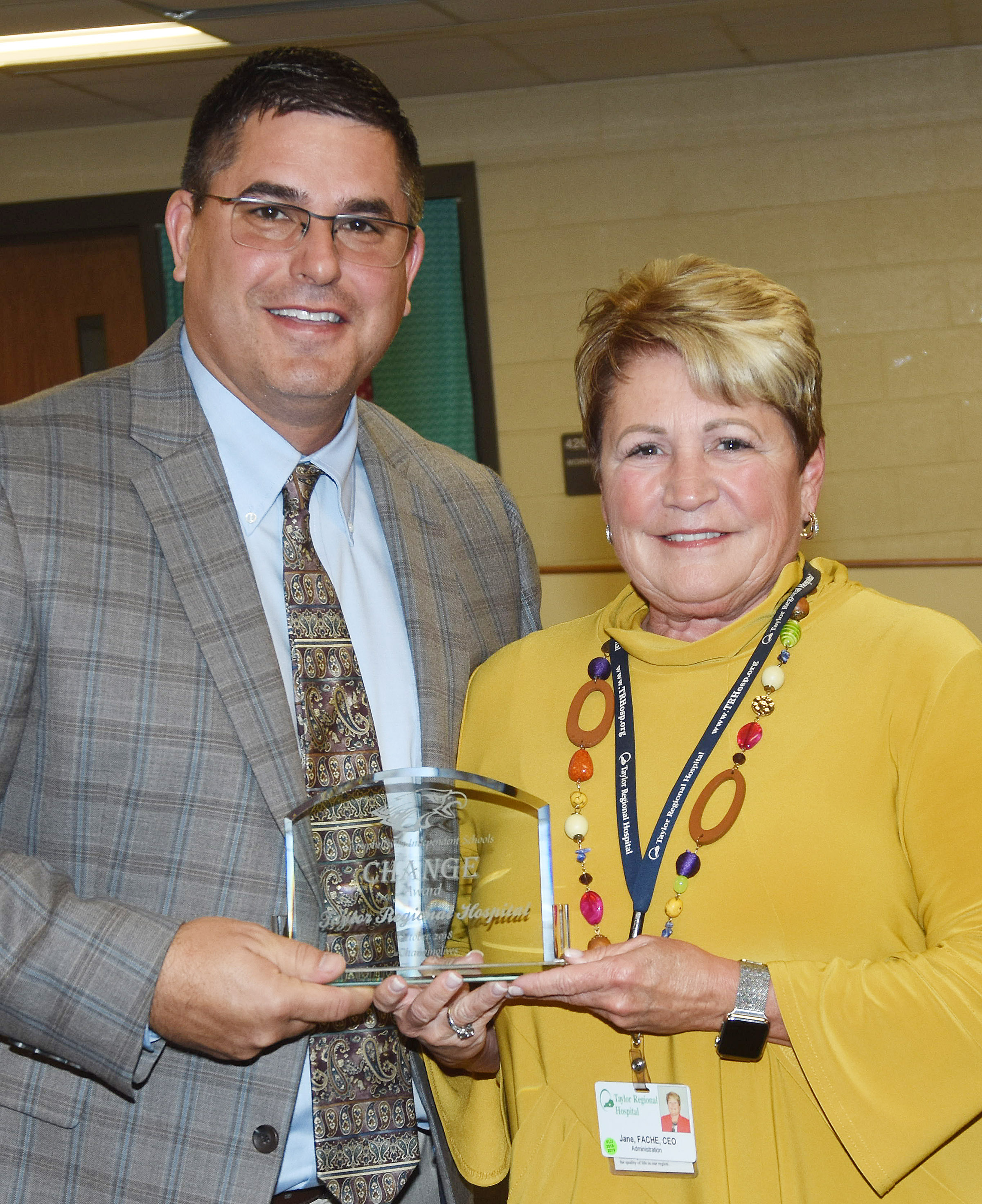 Campbellsville Independent Schools Superintendent Kirby Smith honors TRH CEO Jane Wheatley with the community Change Award.