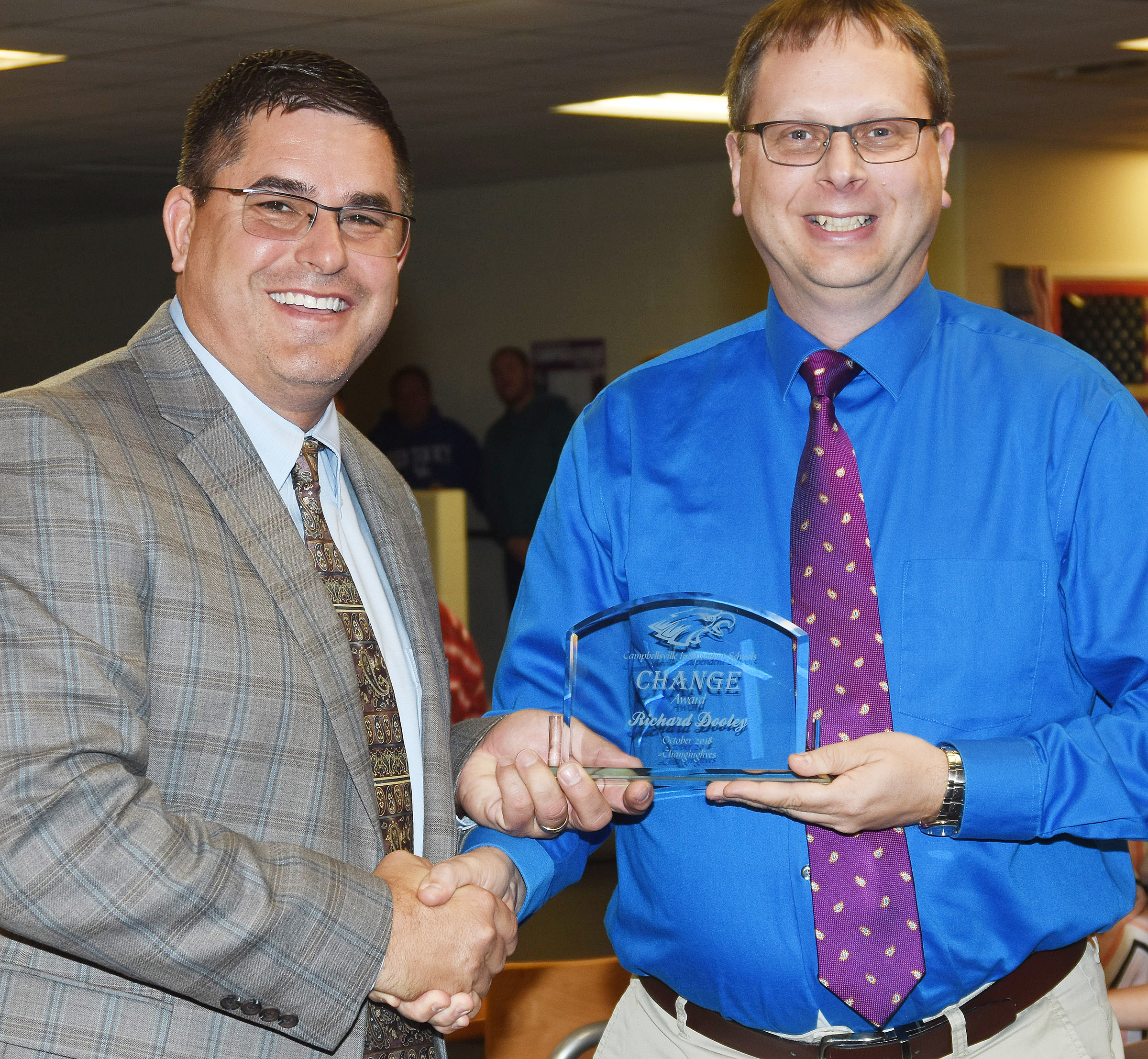 Campbellsville Independent Schools Superintendent Kirby Smith, at left, honors CHS guidance counselor Richard Dooley with the certified Change Award.