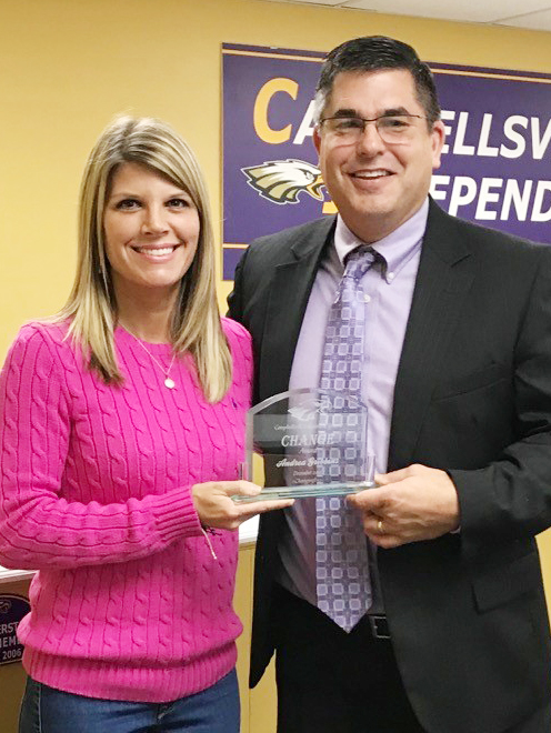 Campbellsville Independent Schools Superintendent Kirby Smith honors CMS teacher Andrea Gribbins with the certified Change Award.