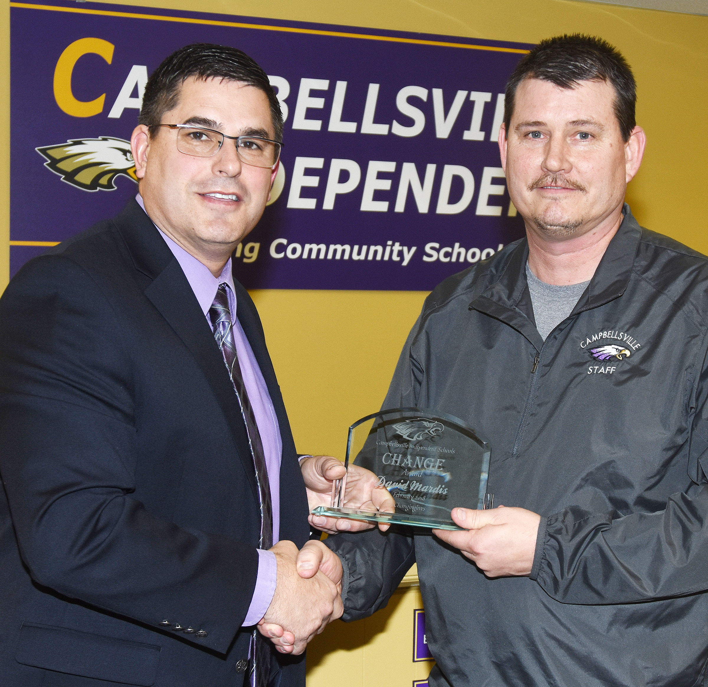 Campbellsville Independent Schools Superintendent Kirby Smith, at left, honors CMS and CHS head custodian David Mardis with the classified Change Award.