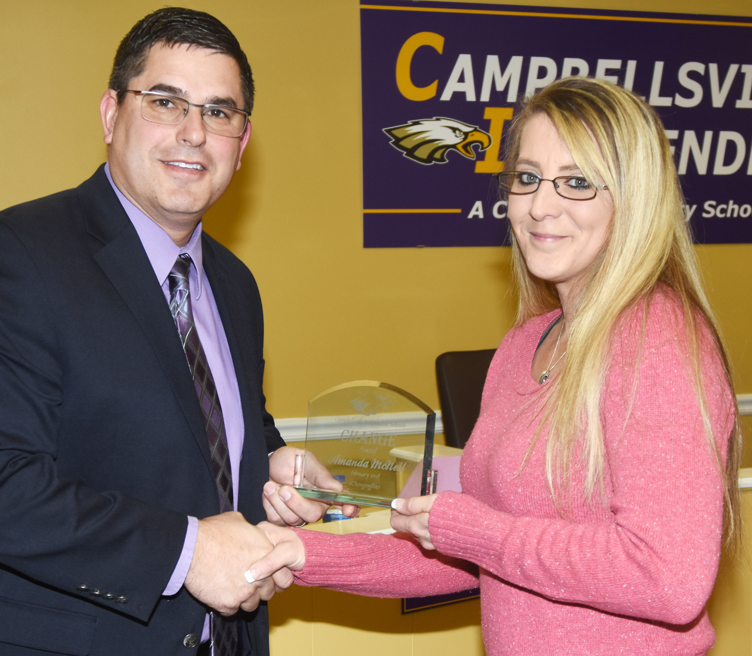 Campbellsville Independent Schools Superintendent Kirby Smith, at left, honors CIS alumnus and parent Amanda McNeill with the community Change Award.