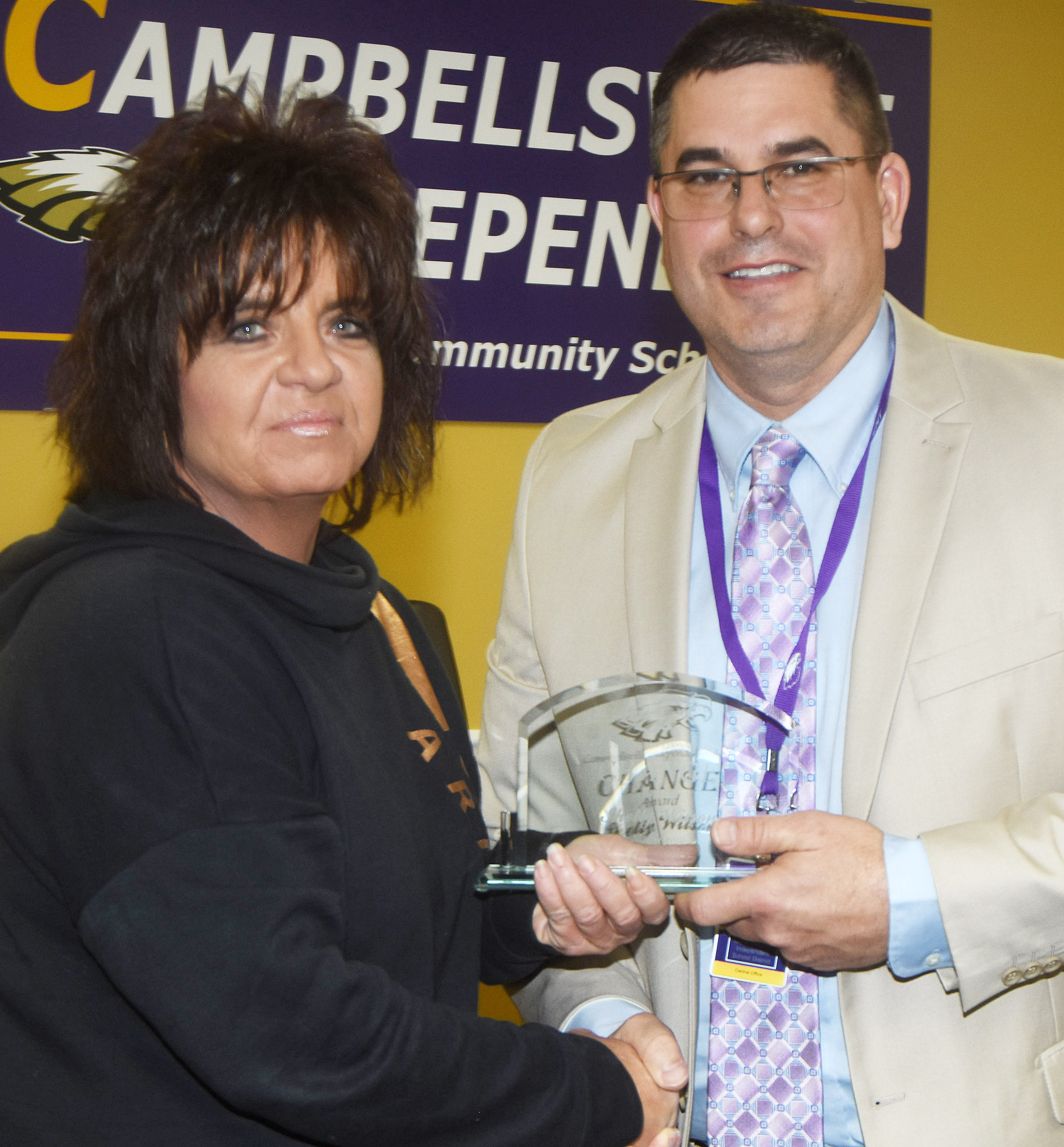 Campbellsville Independent Schools Superintendent Kirby Smith honors CES Cafeteria Manager Shelly Wilson with the classified Change Award.